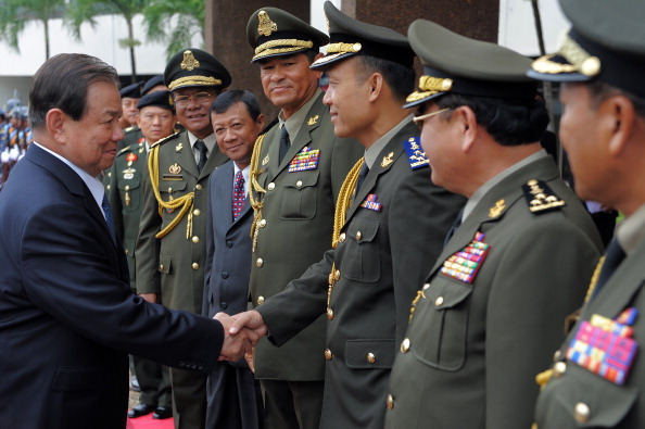 Thai Defense Minister General Yuthasak Sasiprapa, left, shakes hands with Cambodia's internal-security chief Sao Sokha, right, upon his arrival at the Ministry of Defense in Phnom Penh on Sept. 23, 2011