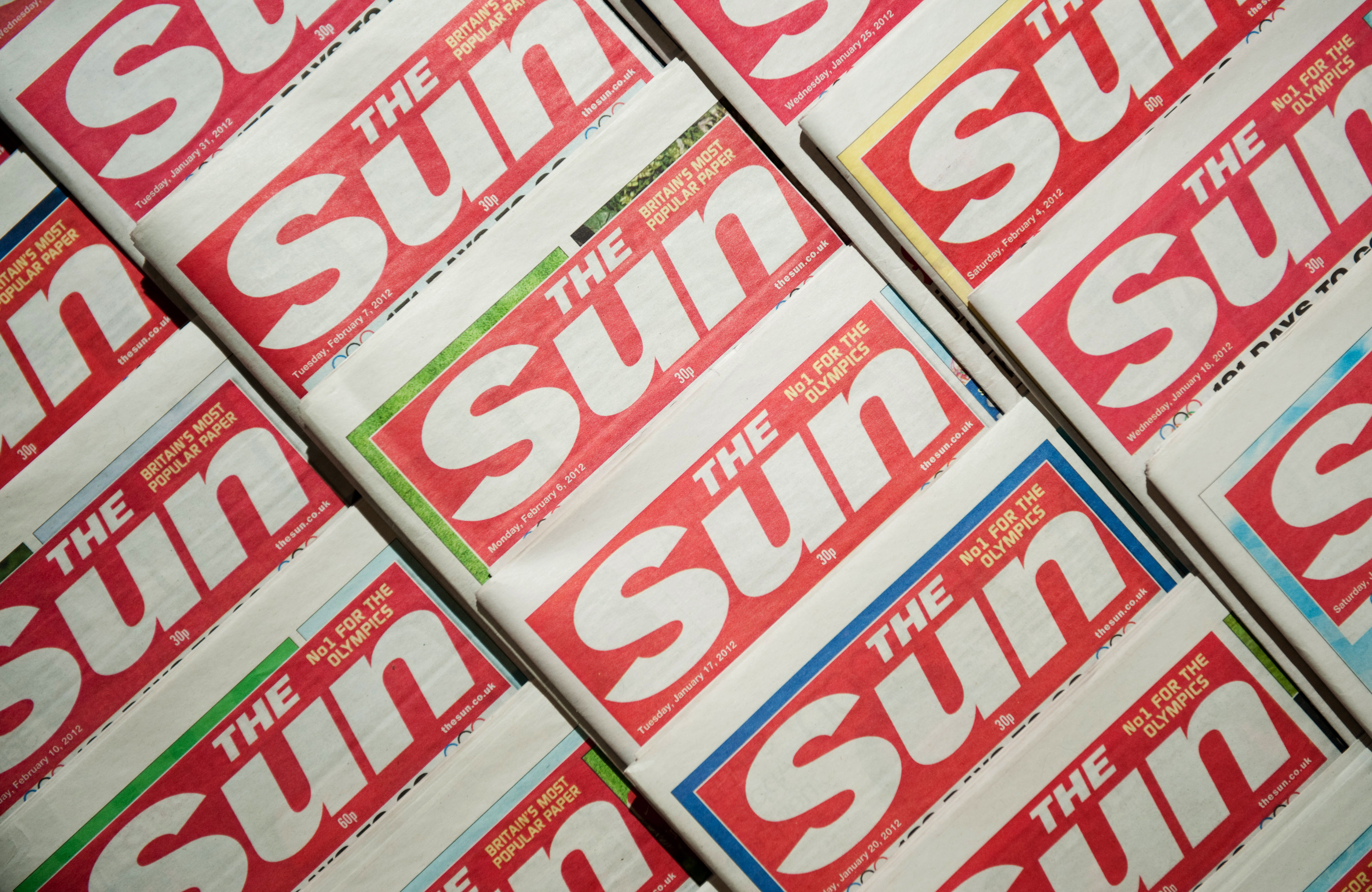 Picture shows an arrangement of copies of The Sun newspaper front pages on February 13, 2012.