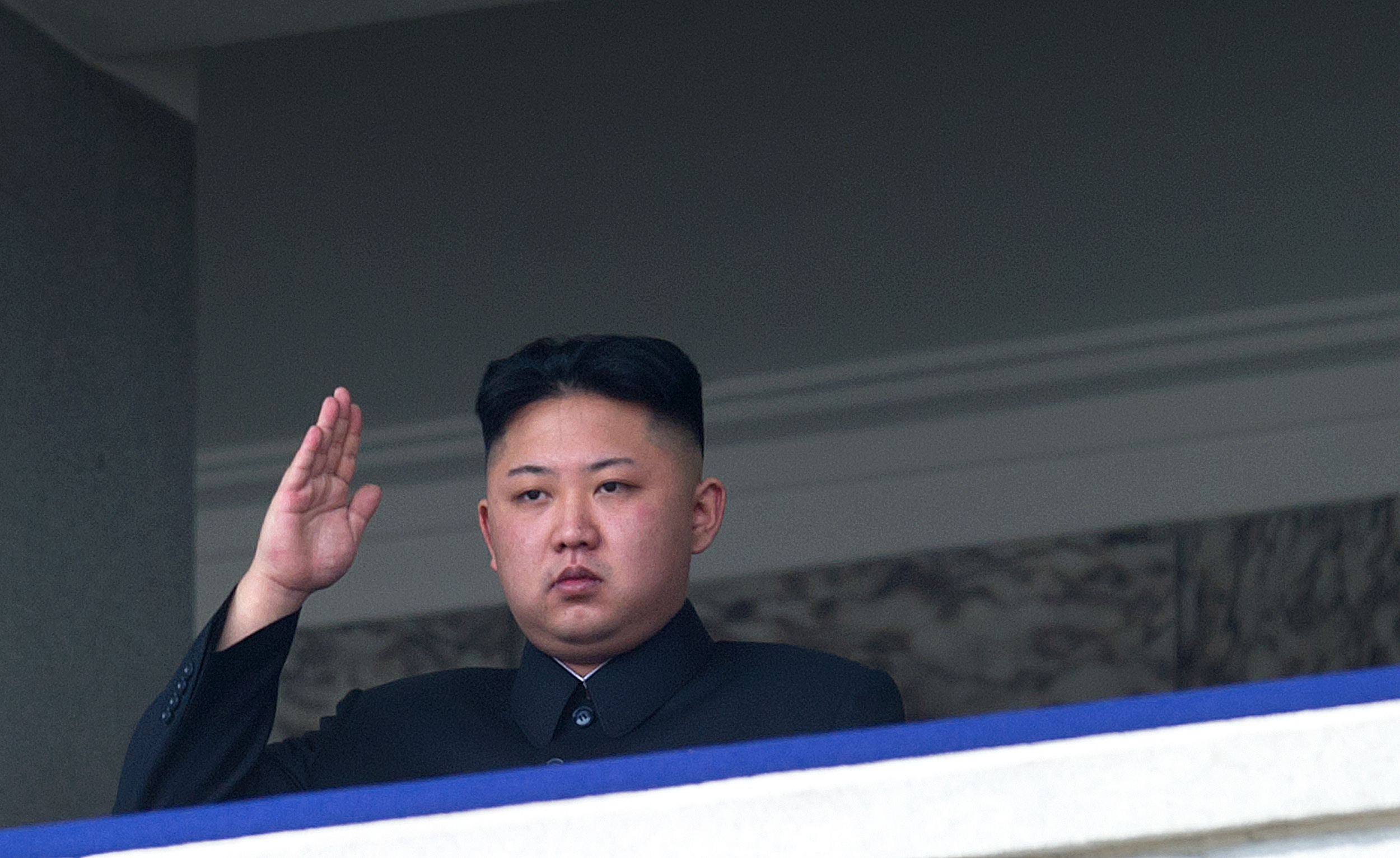 North Korean leader Kim Jong-Un saluting as he watches a military parade in Pyongyang on April 15, 2012 .