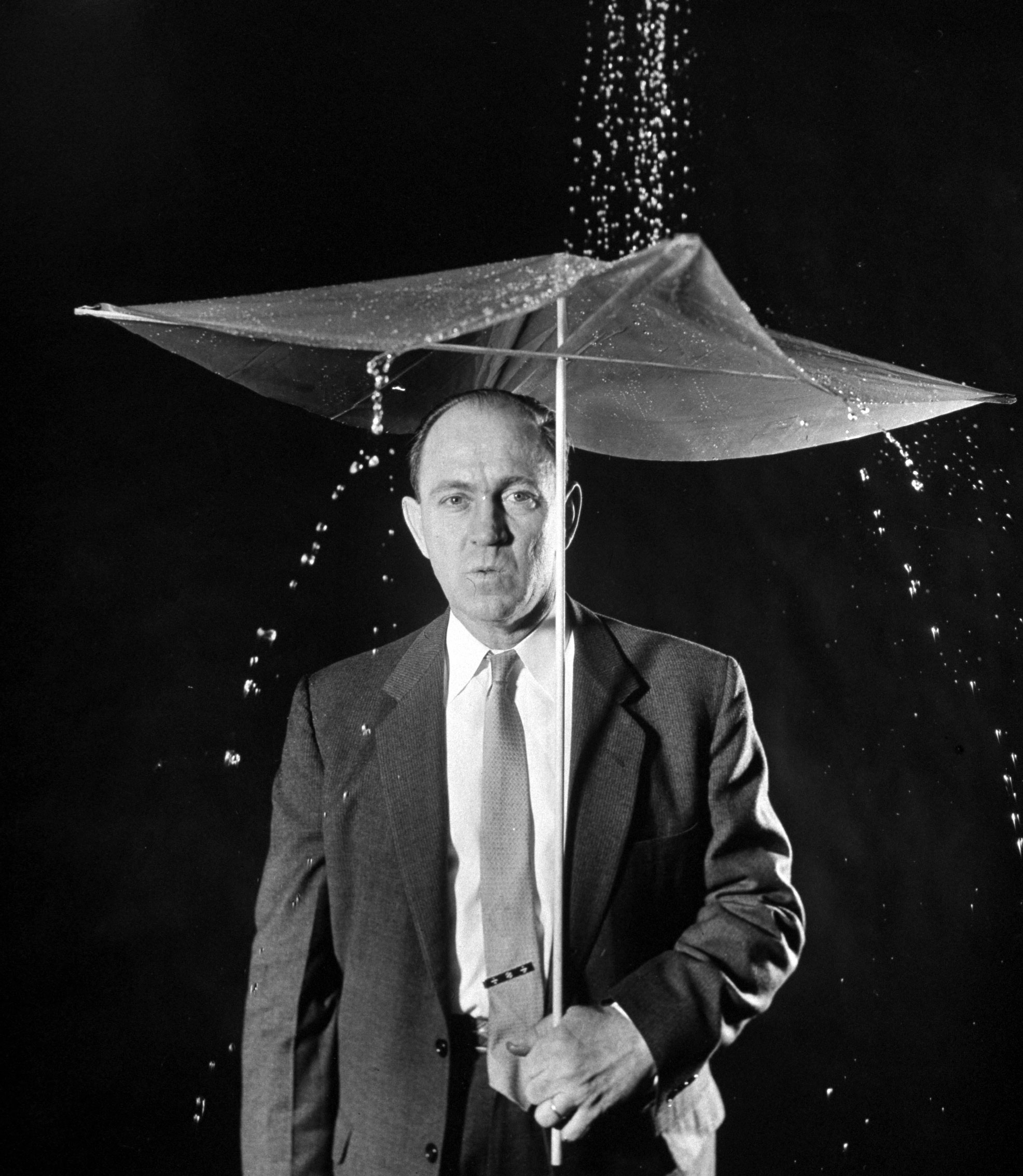 <b>Caption from LIFE.</b> Disposable plastic umbrella to be sold by stores to customers stranded in sudden showers by the inventor Harry Heavner.