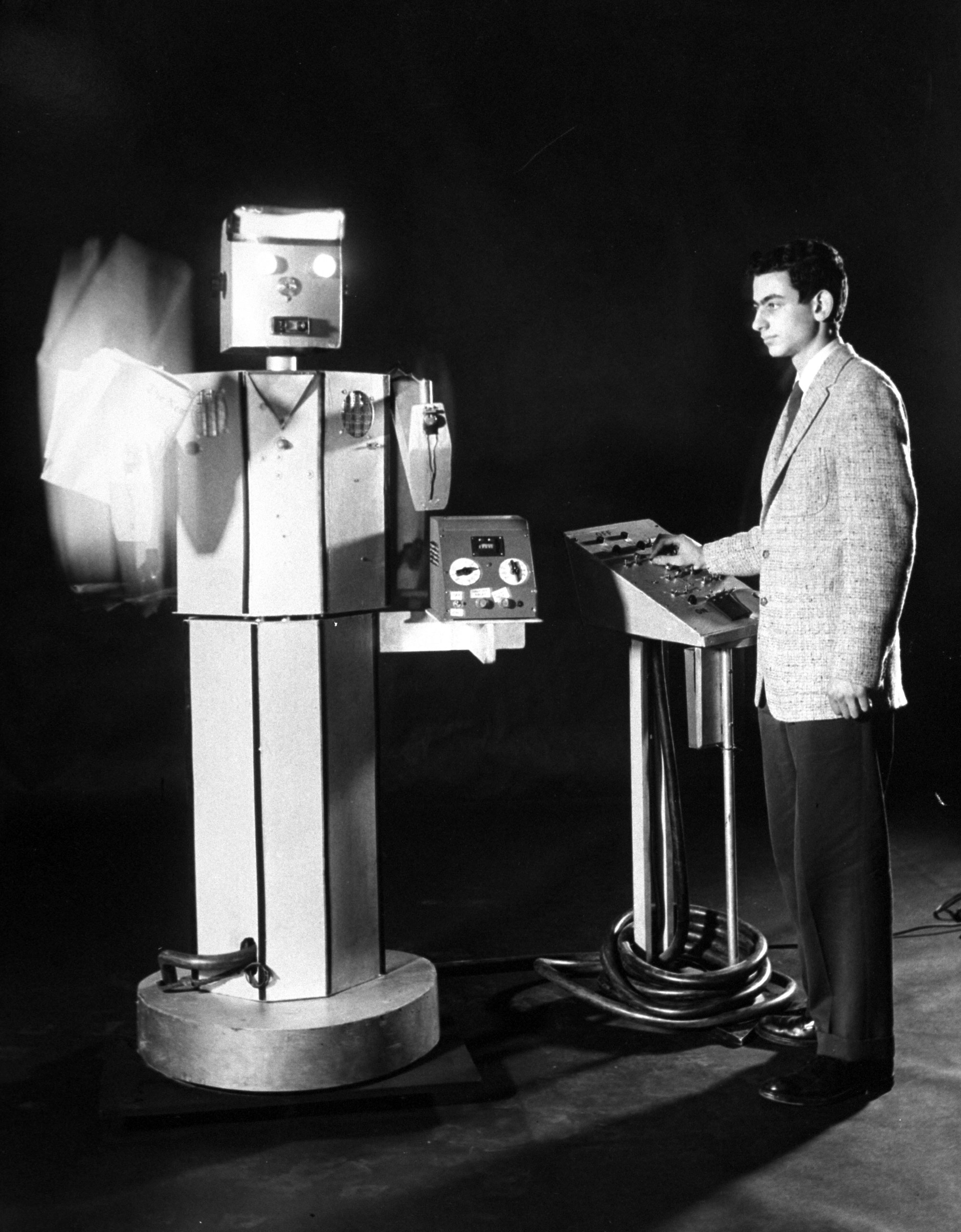 "14-year-old inventor Donald Rich with ""Robotron,"" a walking robot designed as a computer."