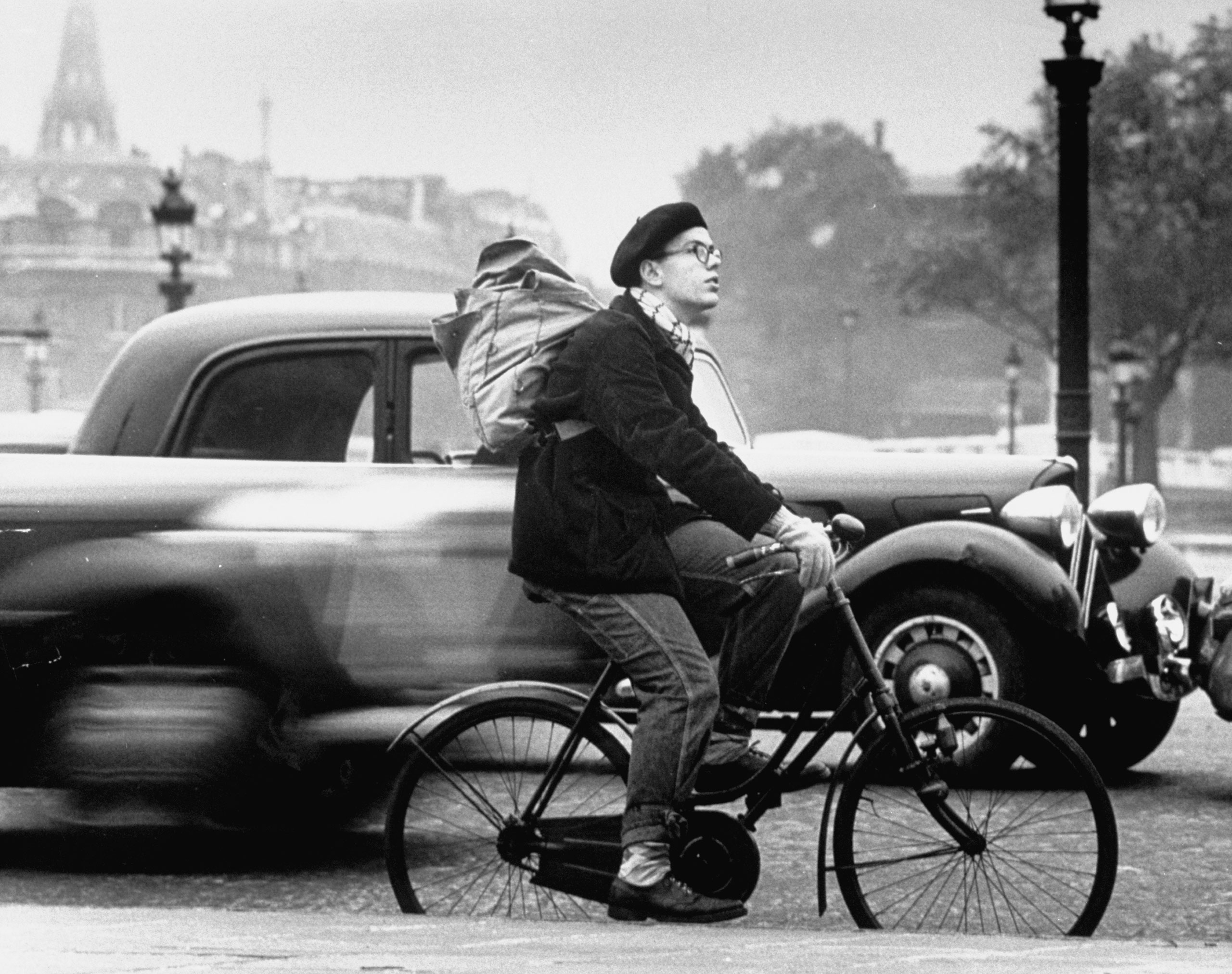 Caption from LIFE. French look gives Ed Perregaux, from Connecticut the reputation of being  a character.  He wears a beret and pack, rides a bike which he bought at the Flea Market.