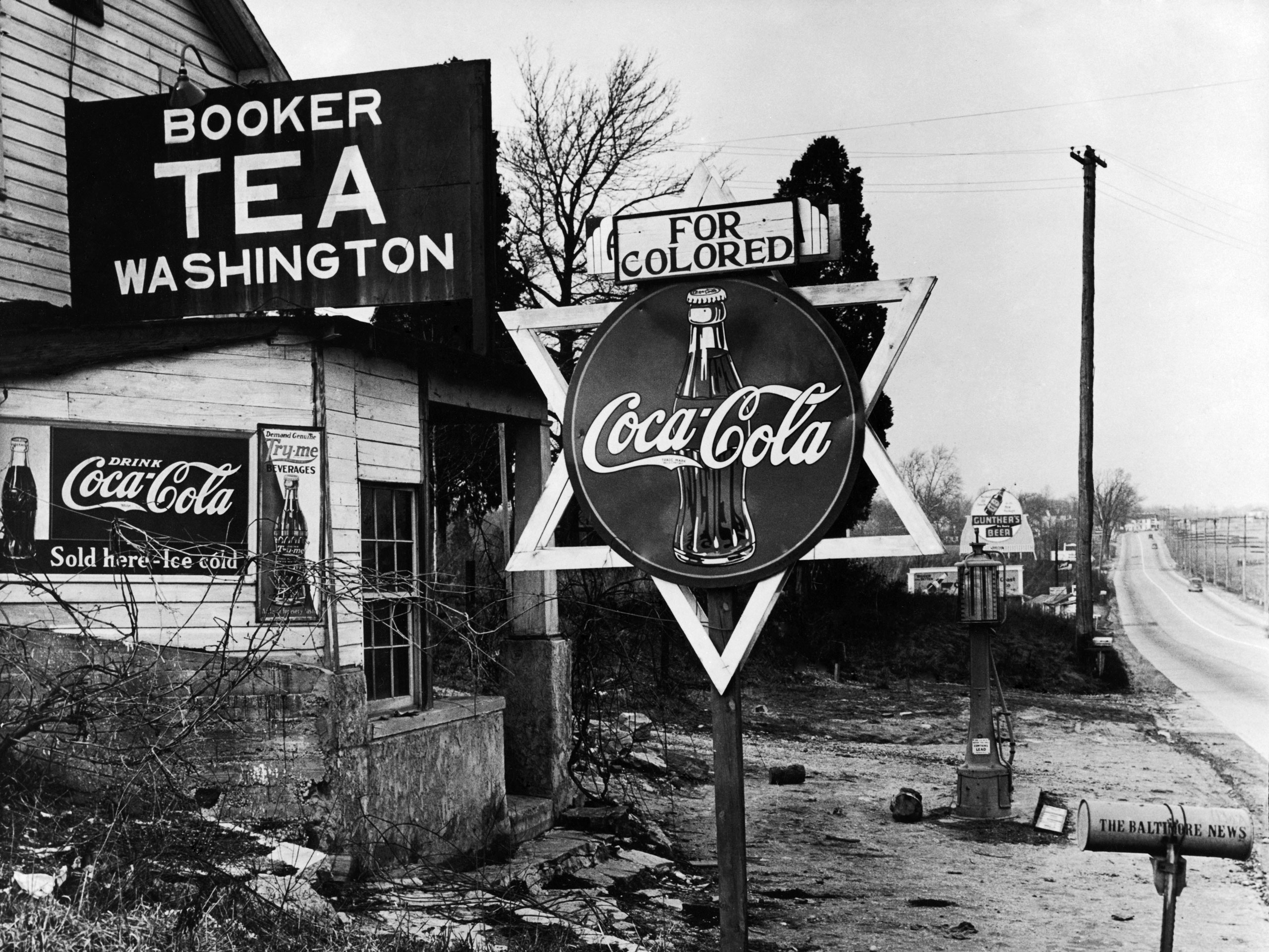 "Coca-Cola signs at a roadside store marked ""For Colored,"" 1938."