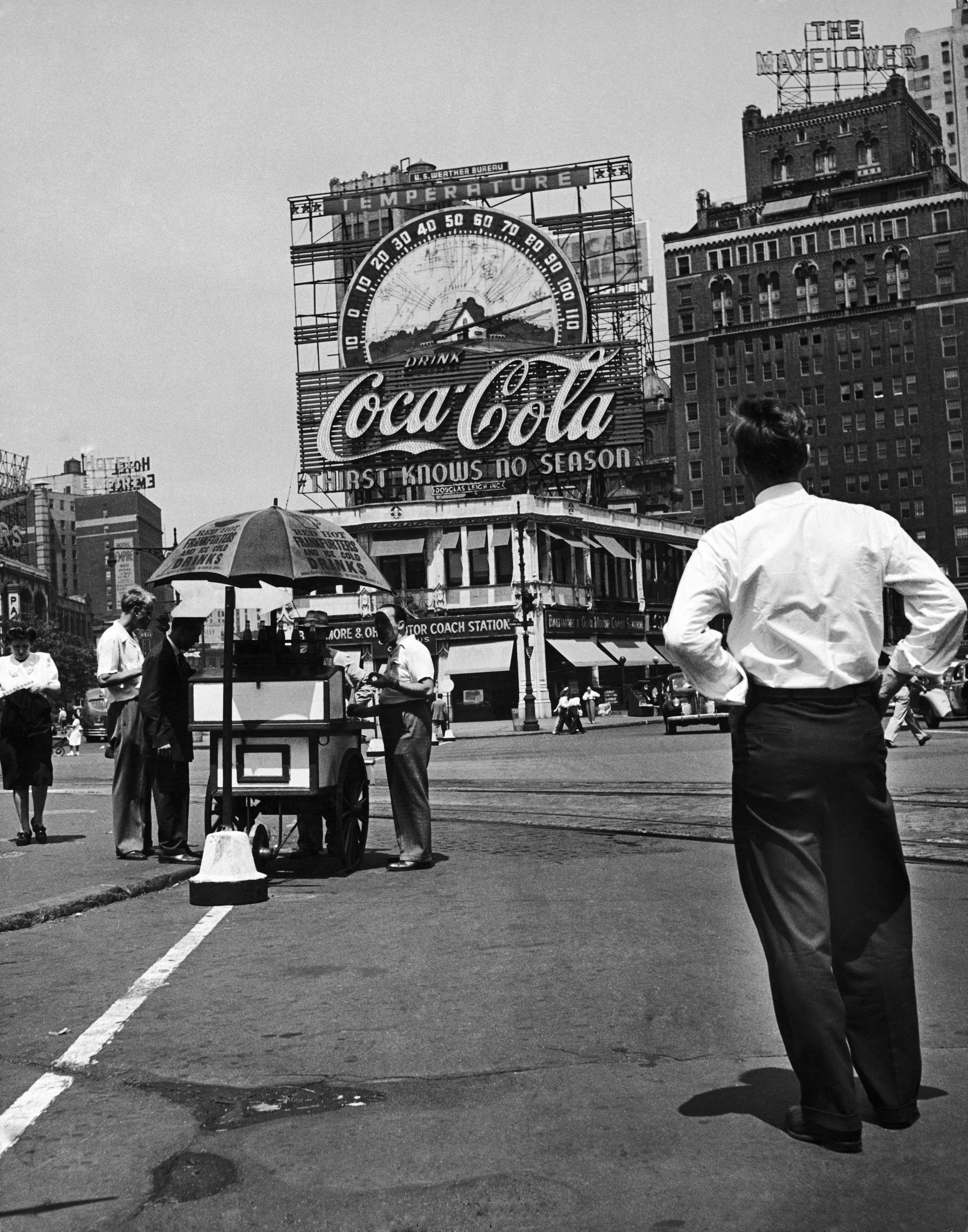 A man ponders a Coca-Cola ad in Columbus Circle in Manhattan during a heat wave in 1944.
