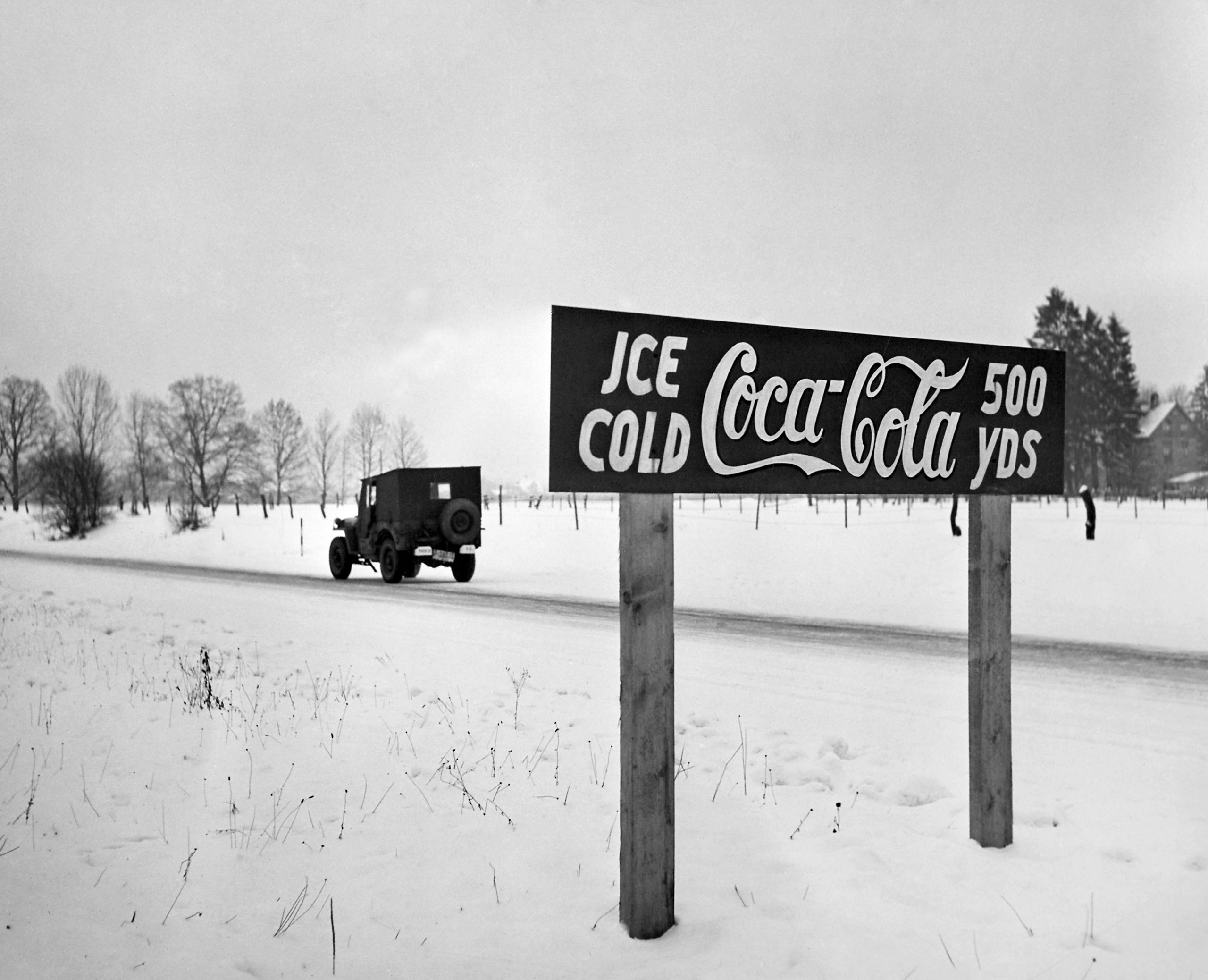 A Coca-Cola road sign beckons on the Autobahn between Munich and Salzberg, Germany, 1947.