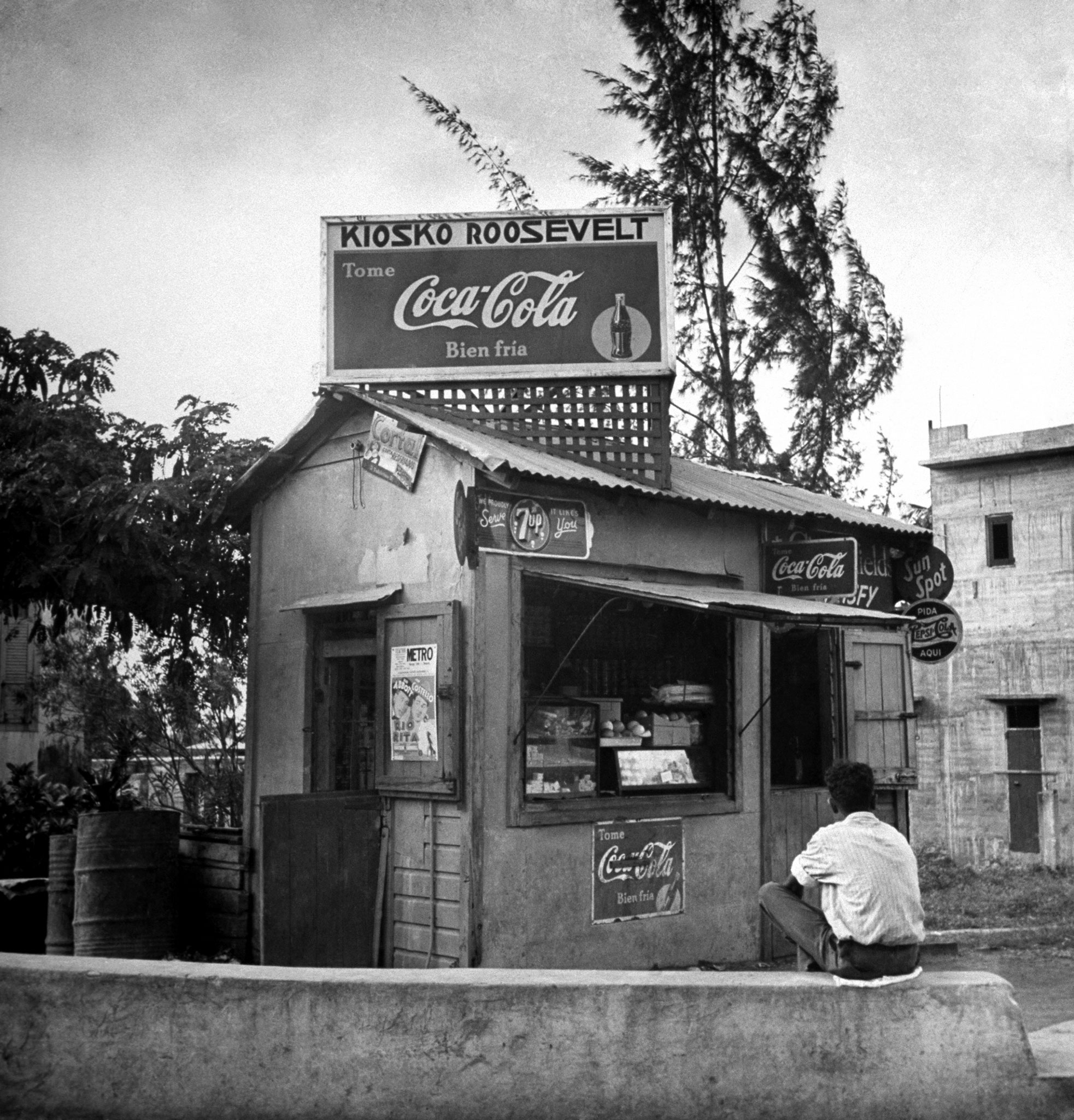 A drugstore boasts both Cokes for sale and the name of the then-first lady, Puerto Rico, 1943.