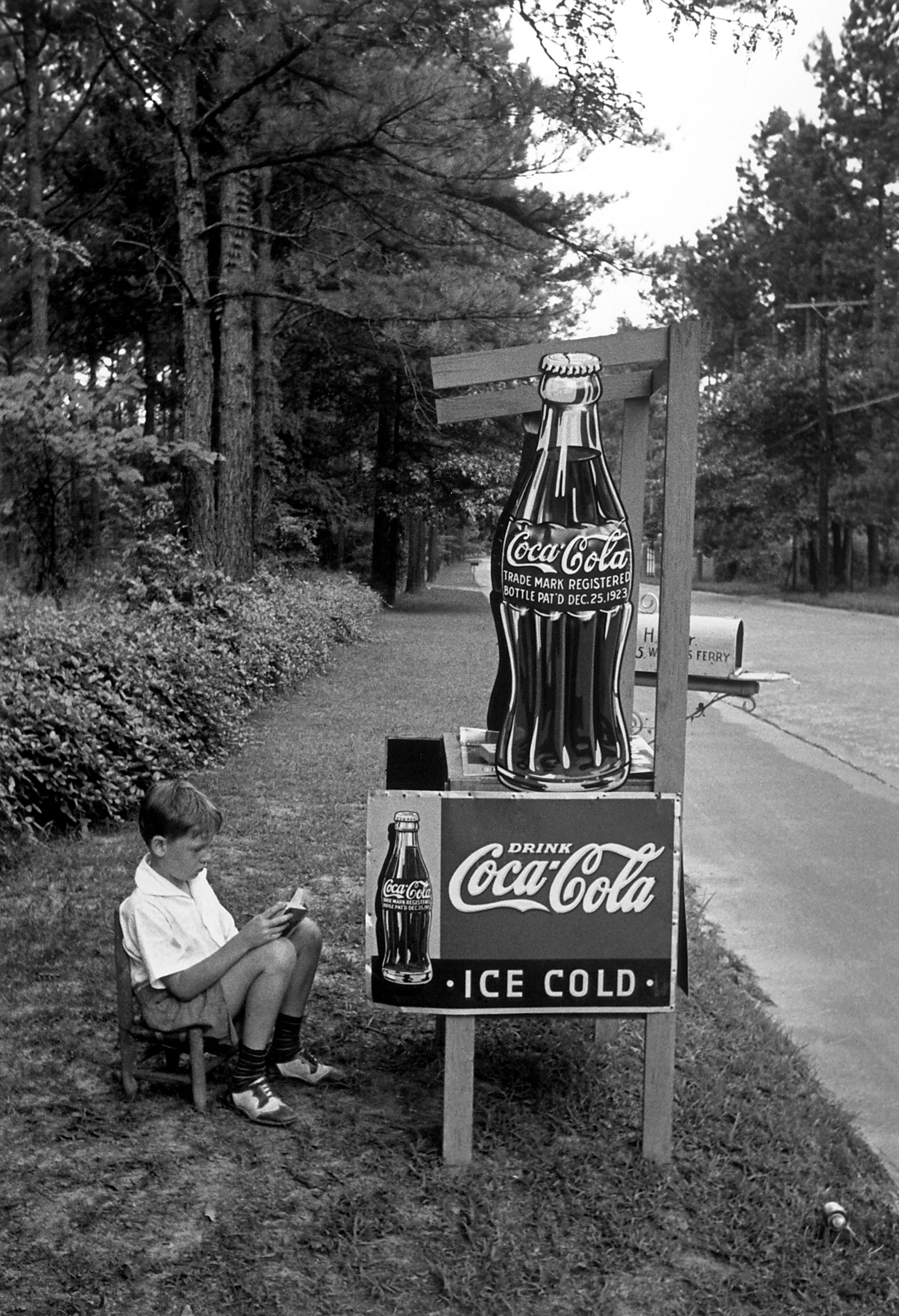 Boy selling Coca Cola from a roadside stand., 1936.