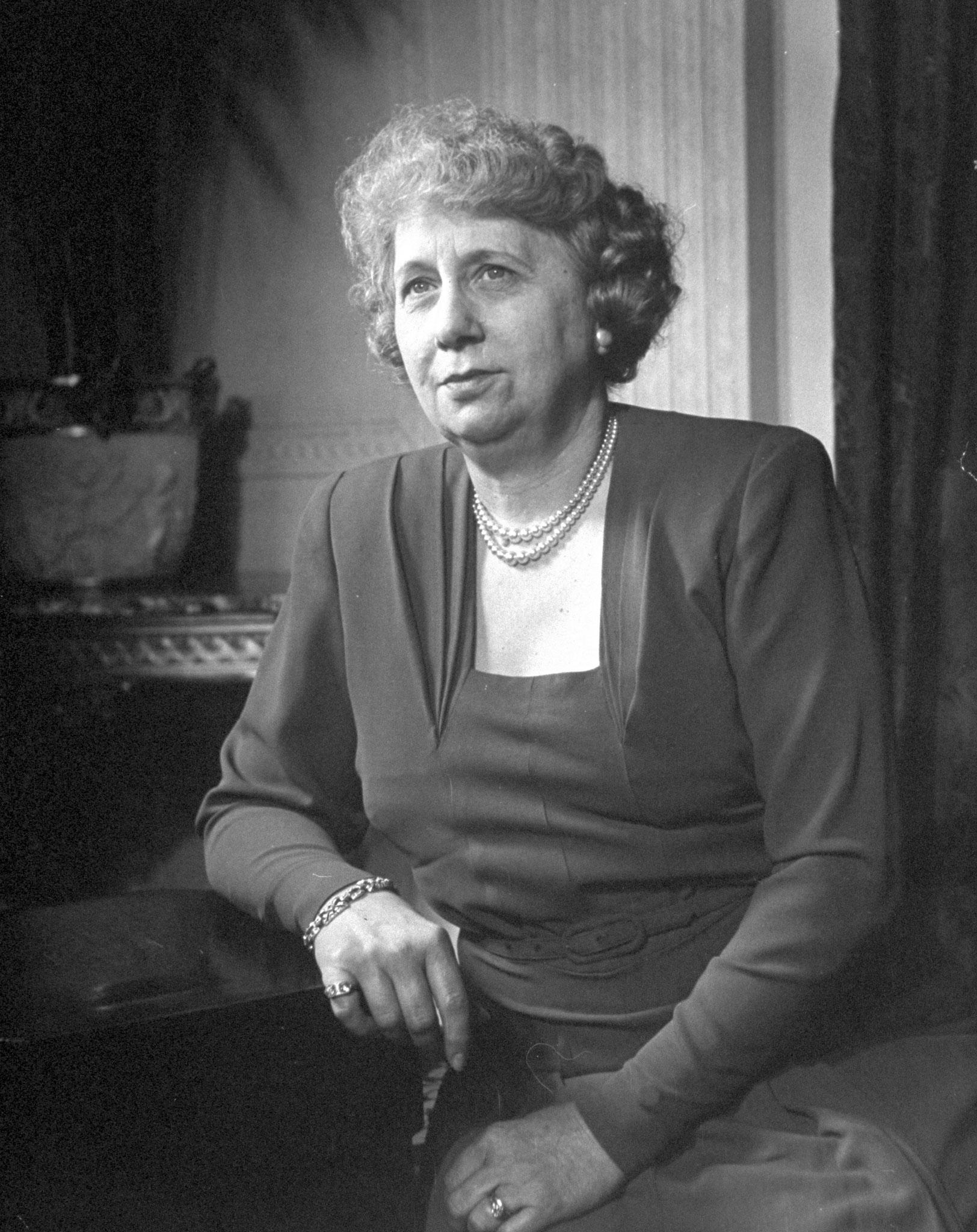 Bess Truman sitting at a desk, 1946.