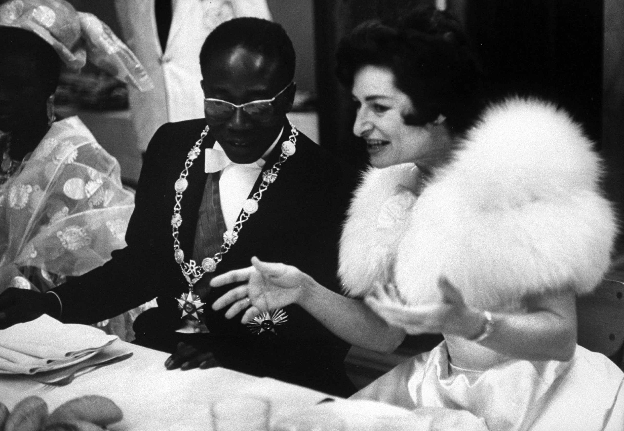 President of Senegal Leopold Senghor with Mrs. Lyndon B. Johnson during the first anniversary of independence from France, 1961.
