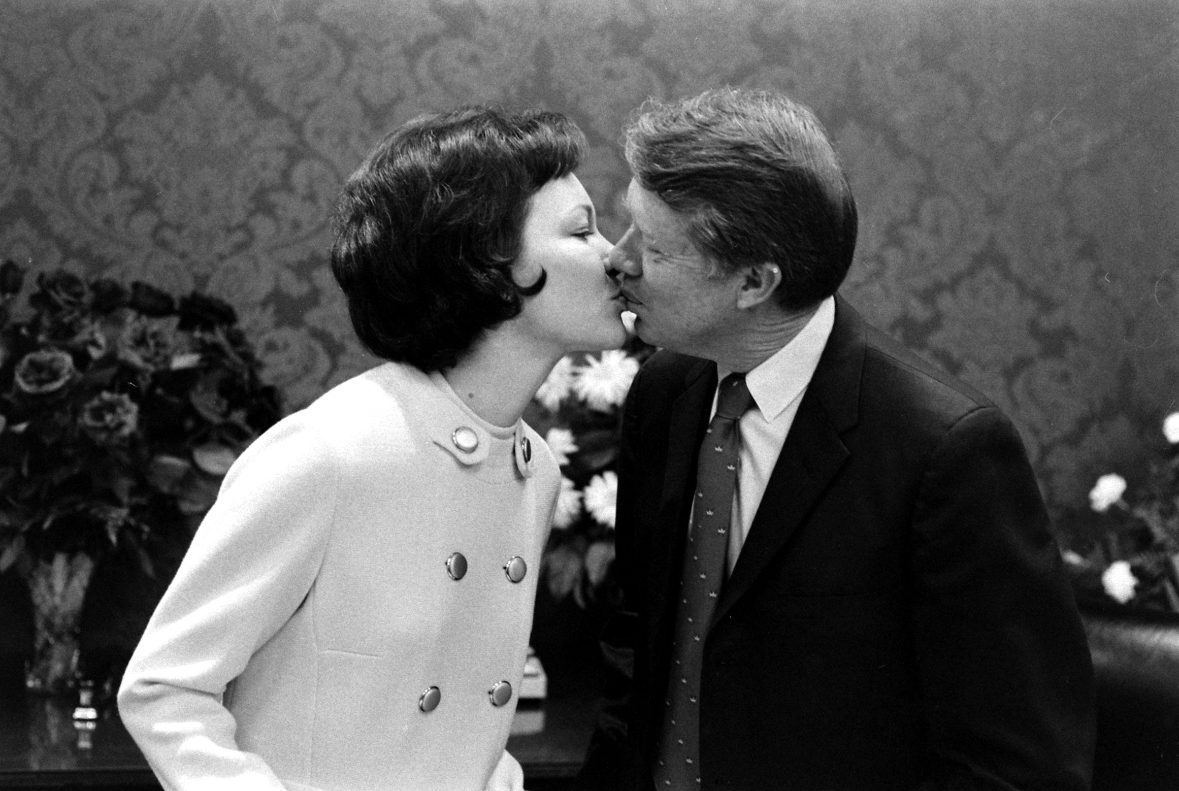 Georgia Governor and future American president Jimmy Carter kissing his wife, Rosalynn, 1971.