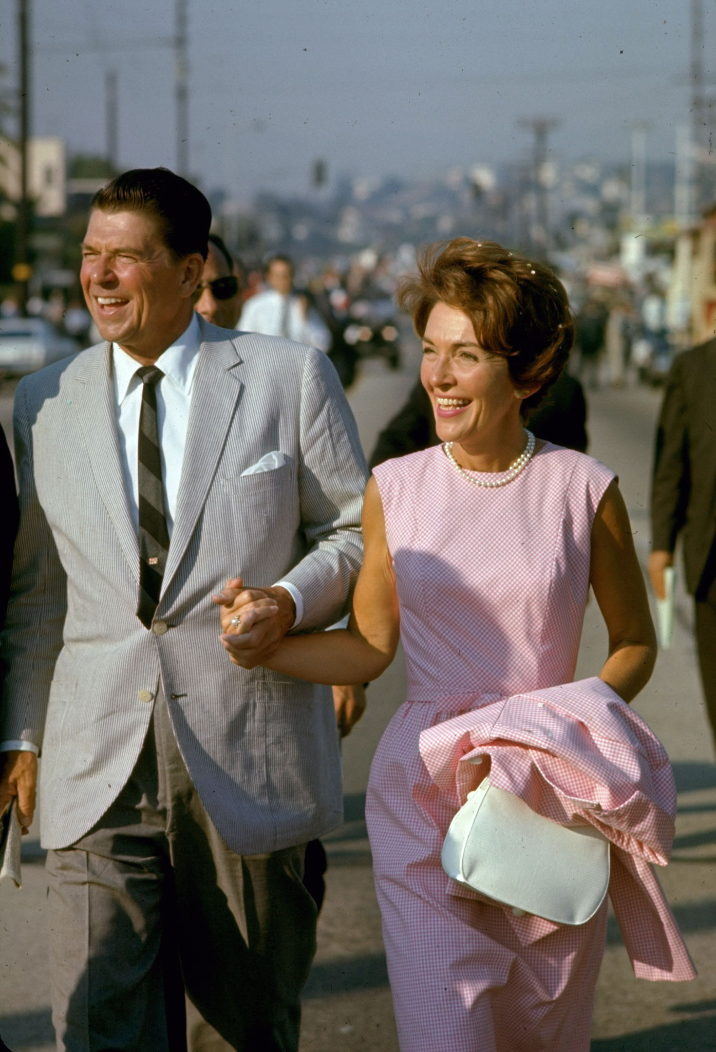 California gubernatorial candidate Ronald Reagan holding hands with wife Nancy while on the campaign trail, 1966.