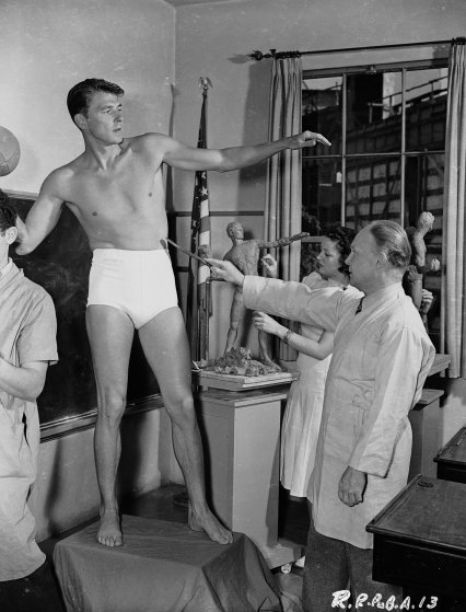 American leading man and future US President, Ronald Reagan modelling for a sculpture, circa 1939.