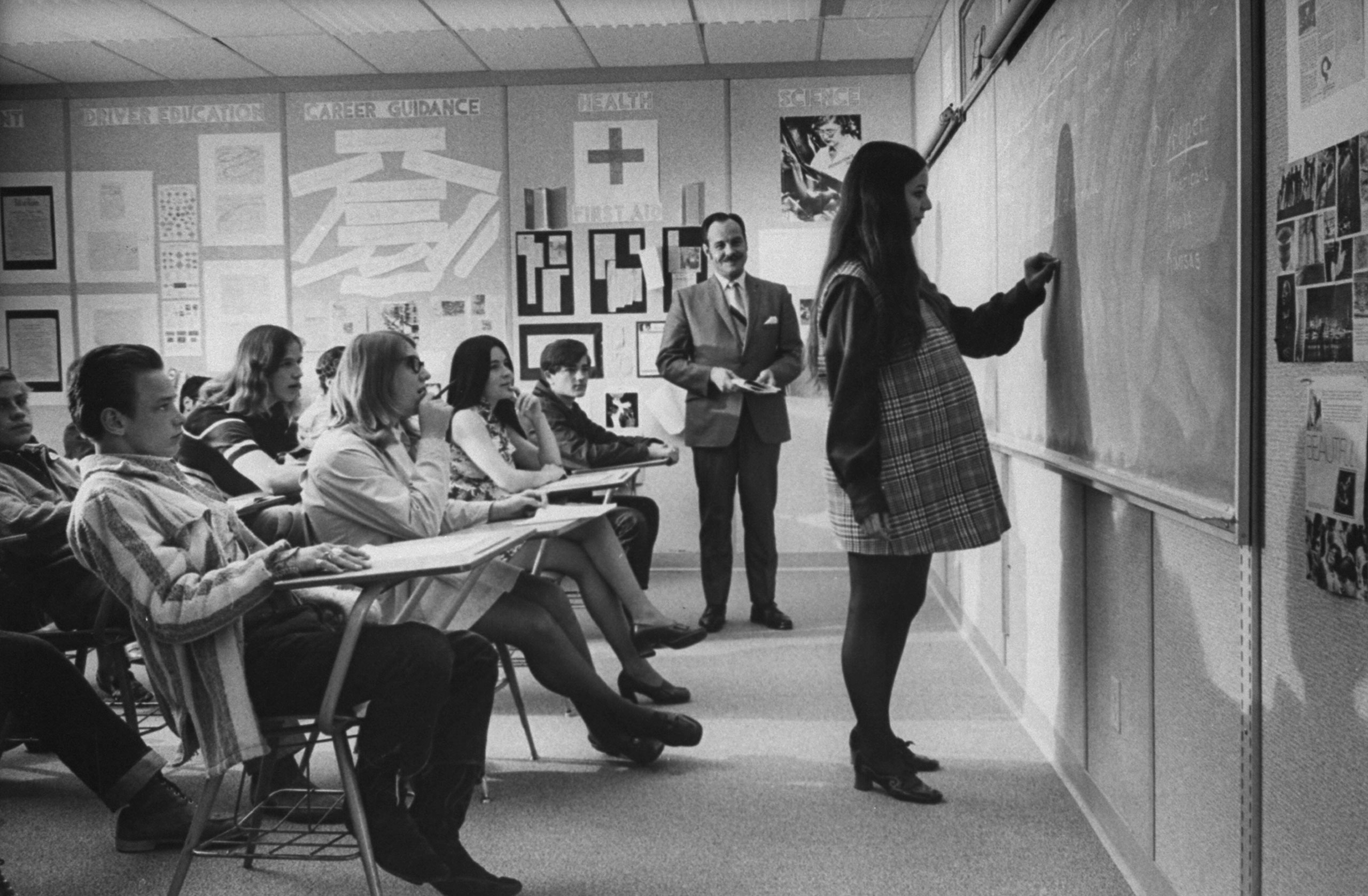 <b>Caption from LIFE.</b> At Citrus High School in California, honor student Judy Fay works at the blackboard during an English class the school's program for pregnant girls started in 1967.