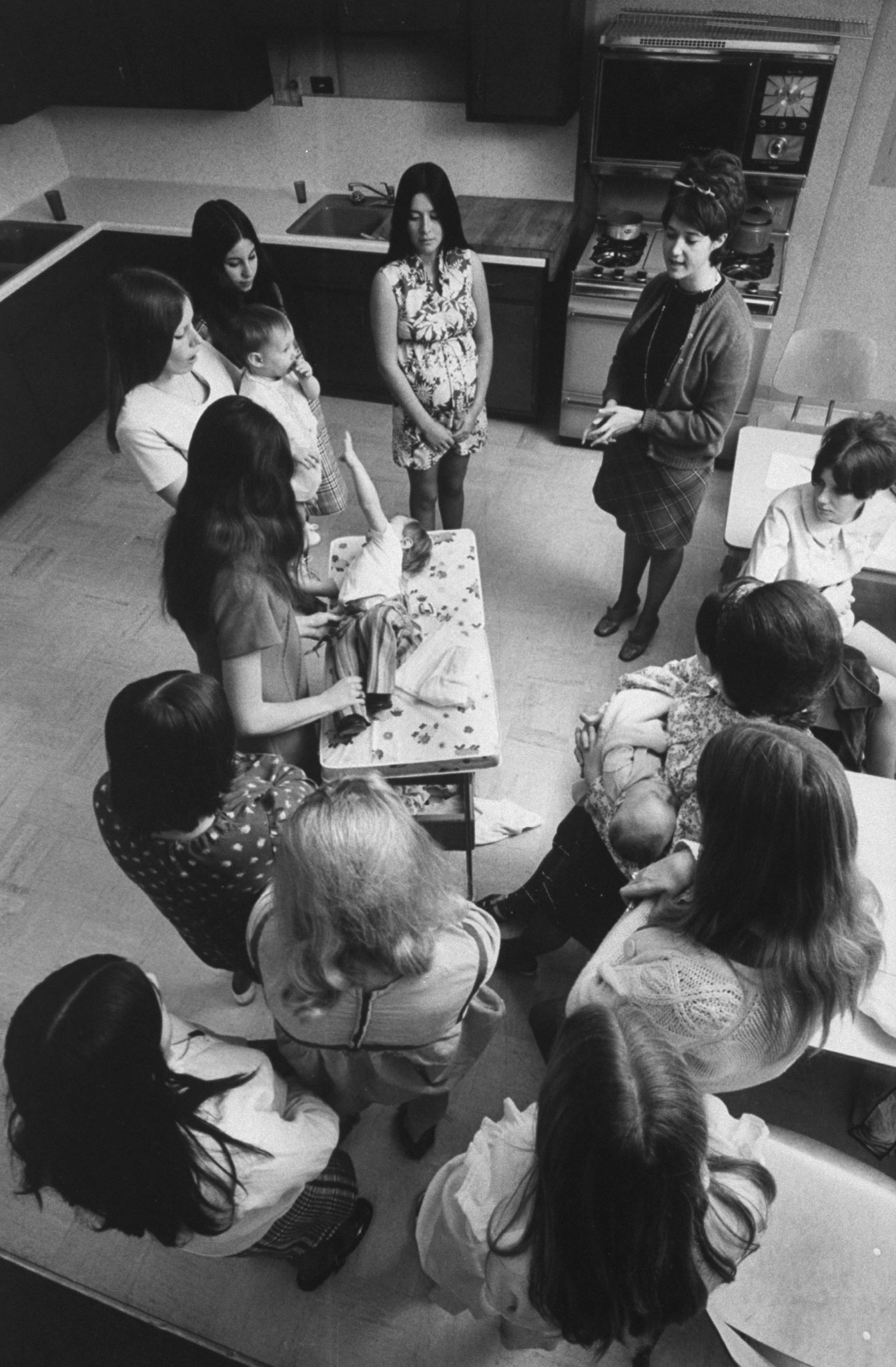 <b>Caption from LIFE.</b> Using her son Charles, Linda Twardowski, a recent Citrus graduate, explains the basics of diaper-changing in a childcare class. The girls also are taught prenatal care, cooking and budgeting.