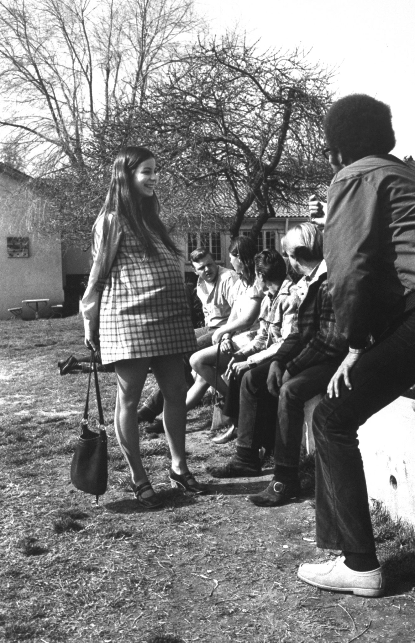 <b>Caption from LIFE.</b> Judy Fay chats with a group of students outside class. Now that there are pregnant girls at Citrus, the boys have cleaned up their language, courteously hold open doors and even push strollers.