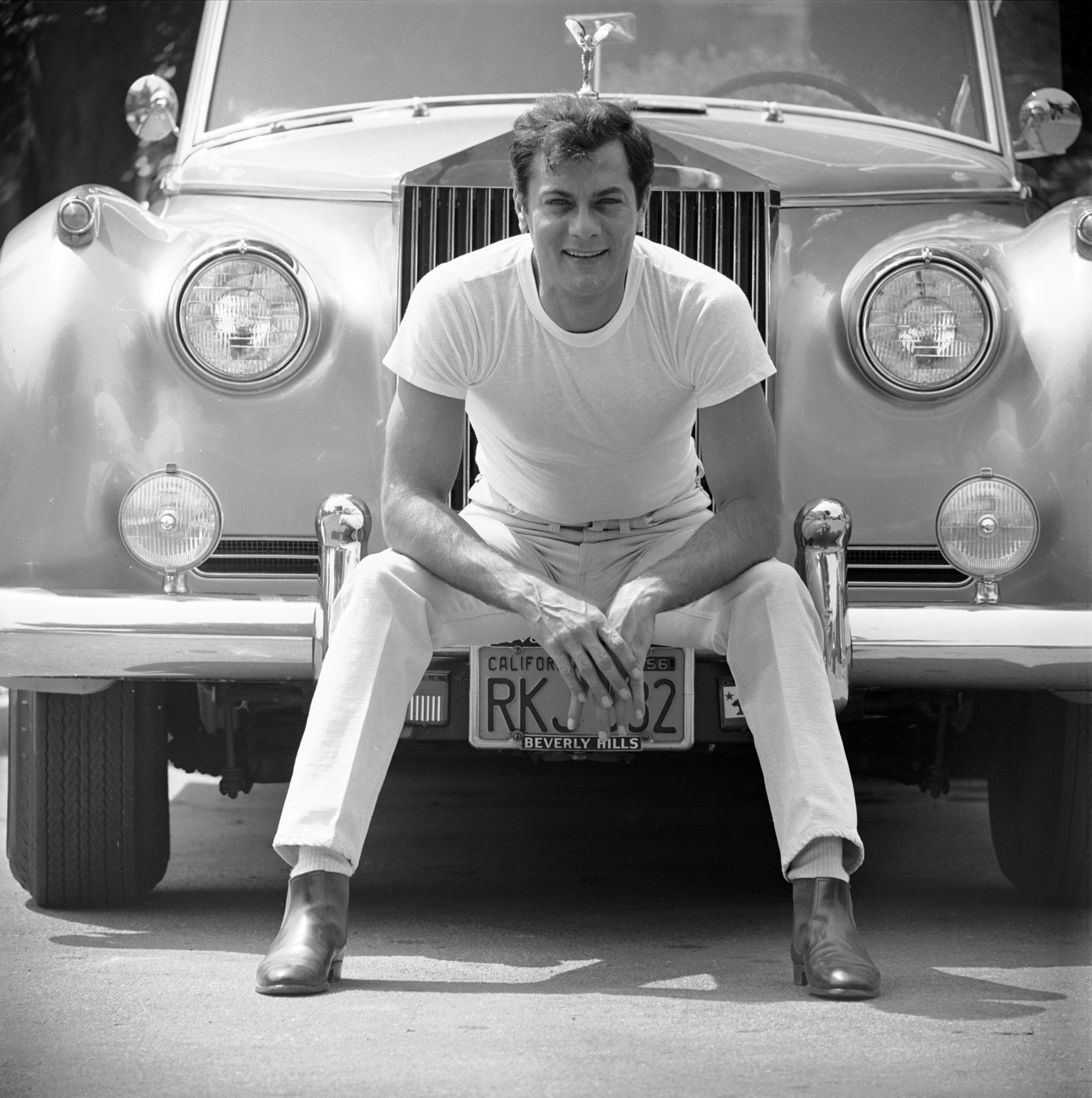 Tony Curtis, who was nominated once. Pictured with his Rolls Royce, 1961.