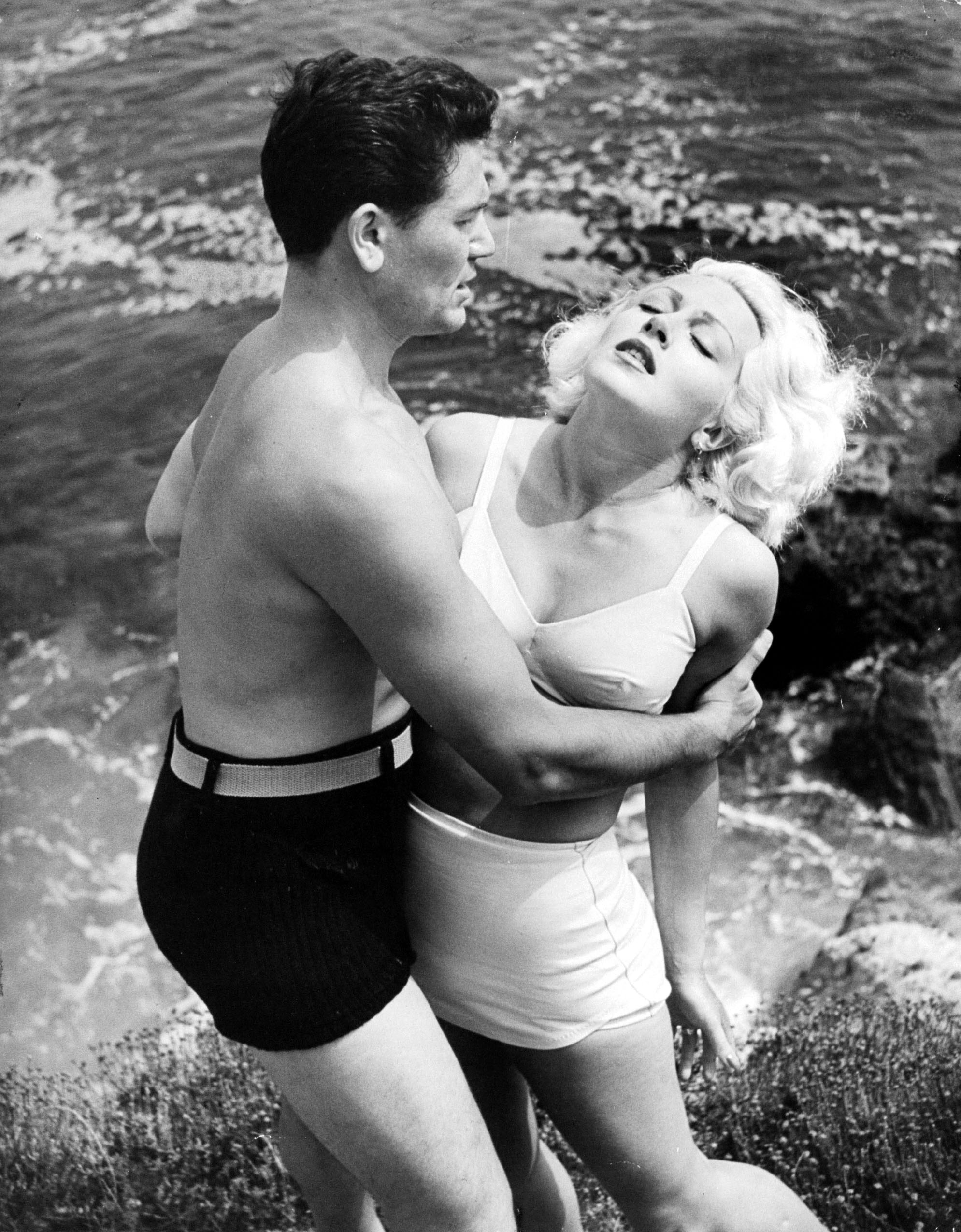 Lana Turner, who was nominated once. Pictured here with John Garfield on Laguna Beach in a scene from <i>The Postman Always Rings Twice</i>, 1945.