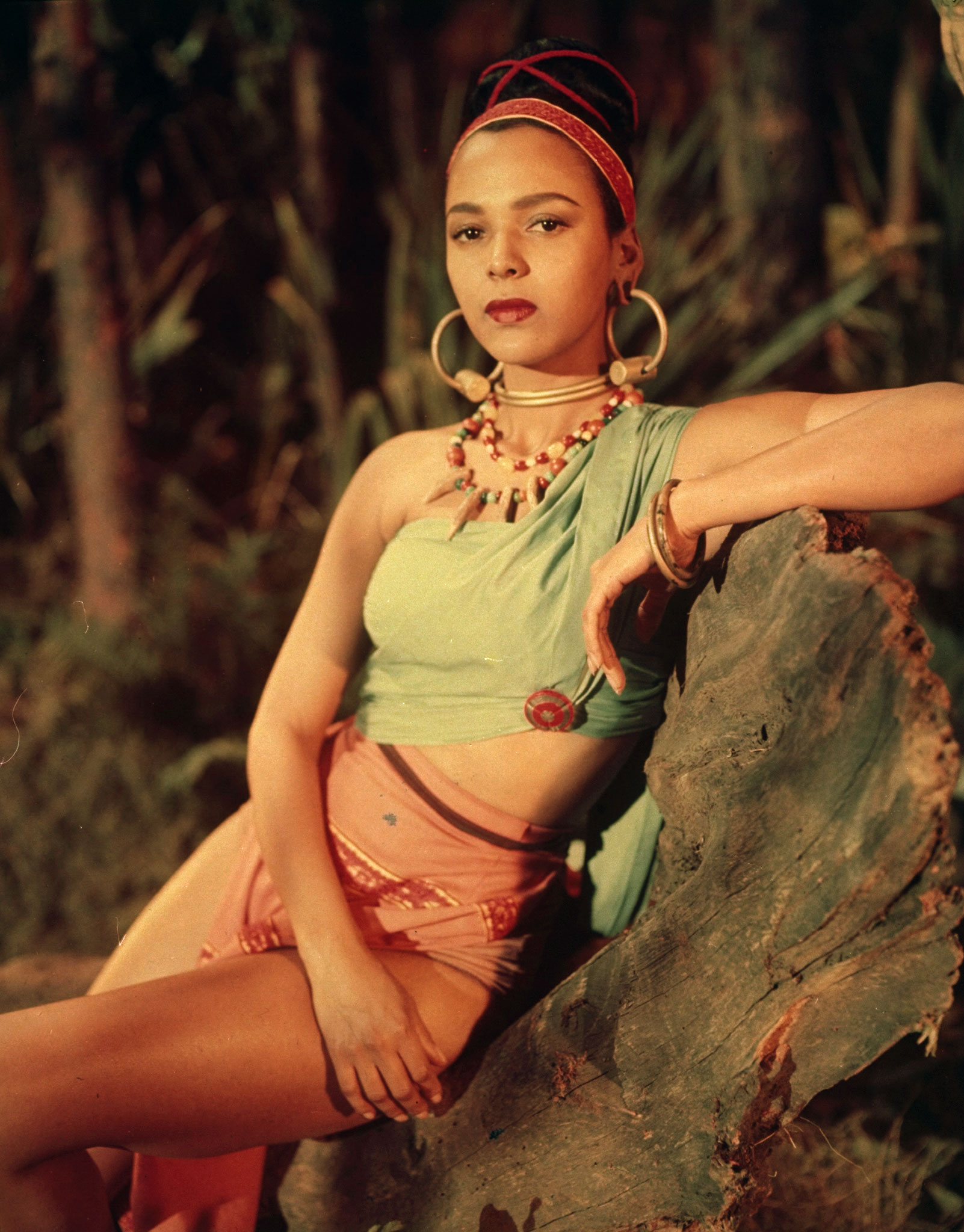 Dorothy Dandridge, who was nominated once, becoming the first African-American to be nominated for a leading role (1955). Pictured posing in costume for <i>Tarzan's Peril</i>, 1951.