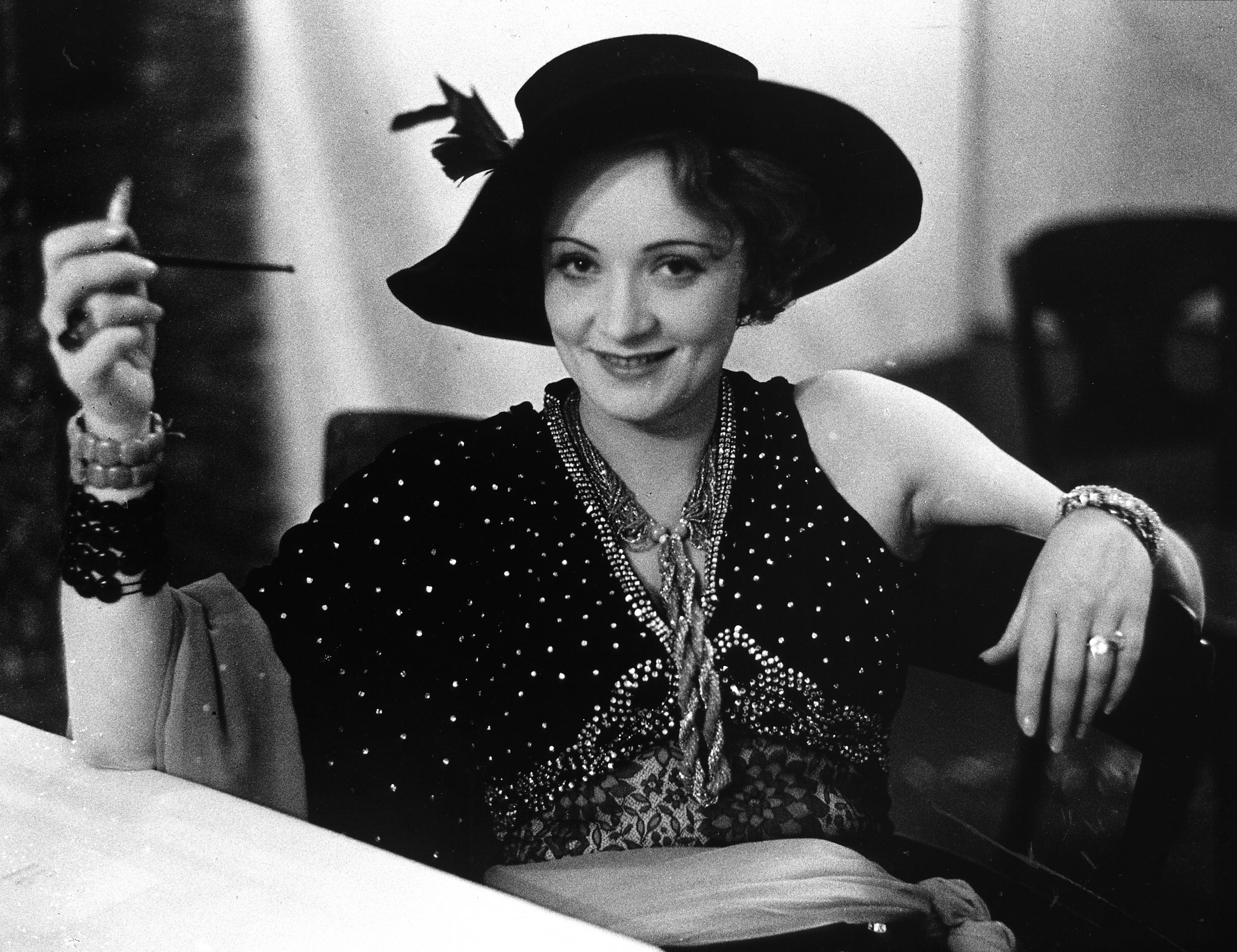 Marlene Dietrich, who was nominated once. Pictured in evening dress and hat during Pierre Ball, 1928.