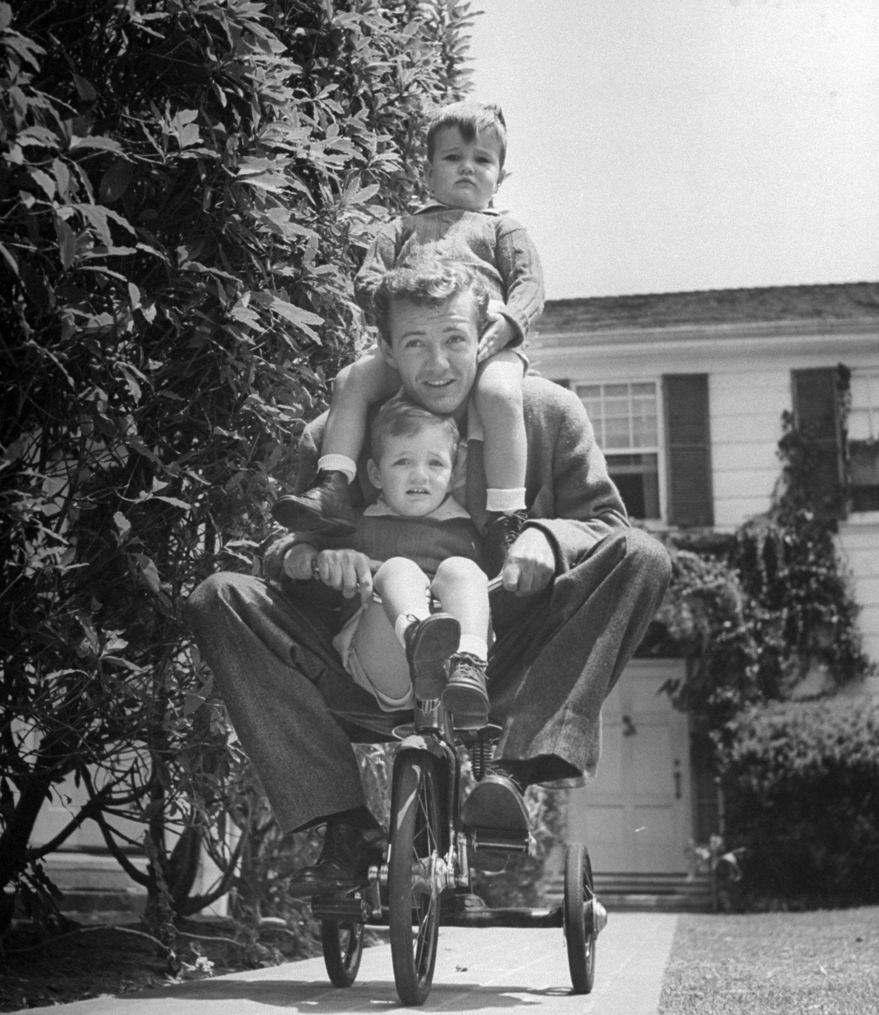 Robert Walker, who was never nominated. Pictured riding a tricycle with his two sons, 1943.