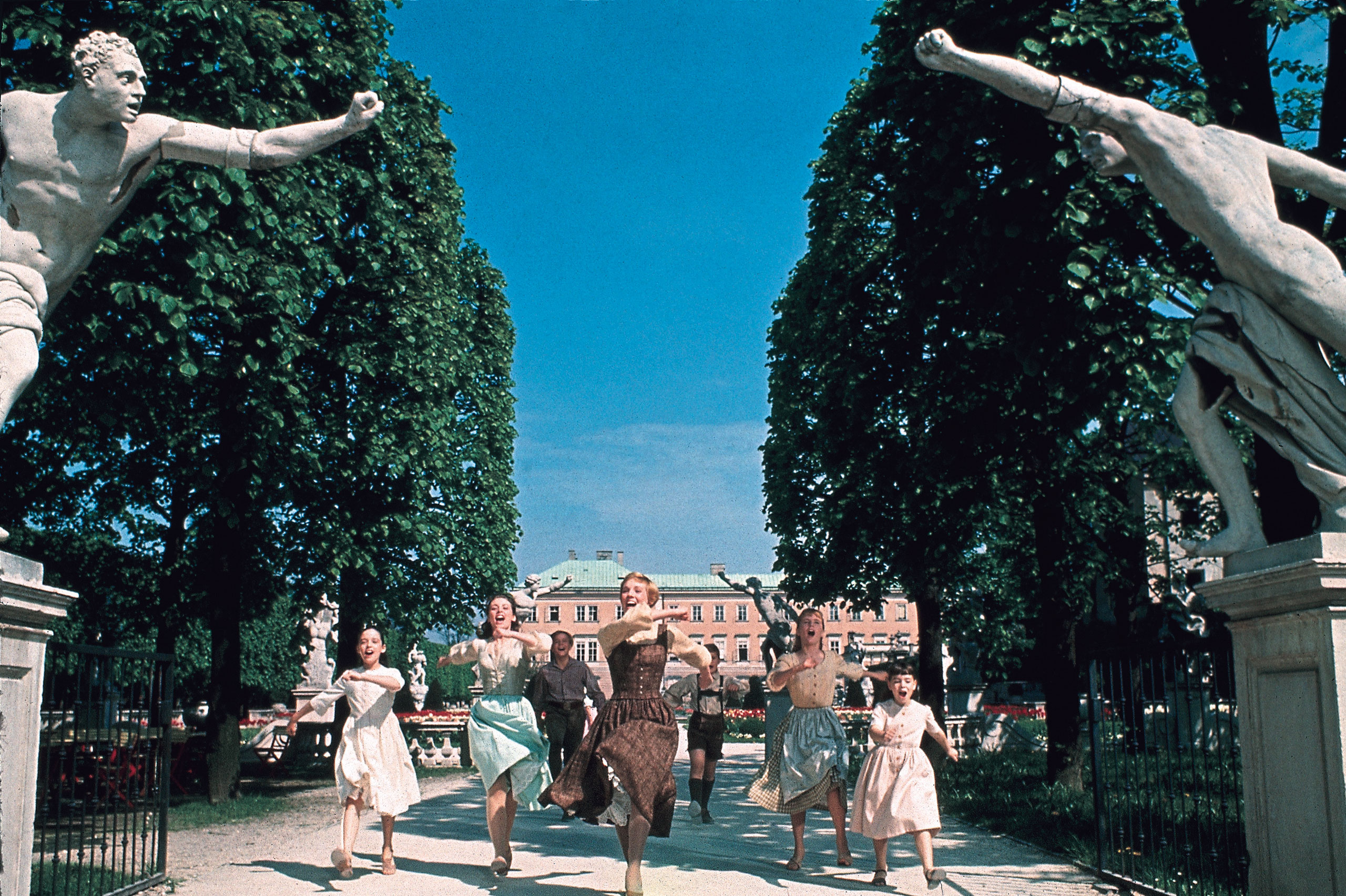 Actress Julie Andrews as Maria von Trapp with her charges in <i>The Sound of Music.</i>