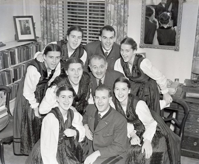 "The Von Trapp Family singers warm up before a performance in New York's Town Hall. The musical ""The Sound of Music"" was based on their life in Austria. December 5, 1938."
