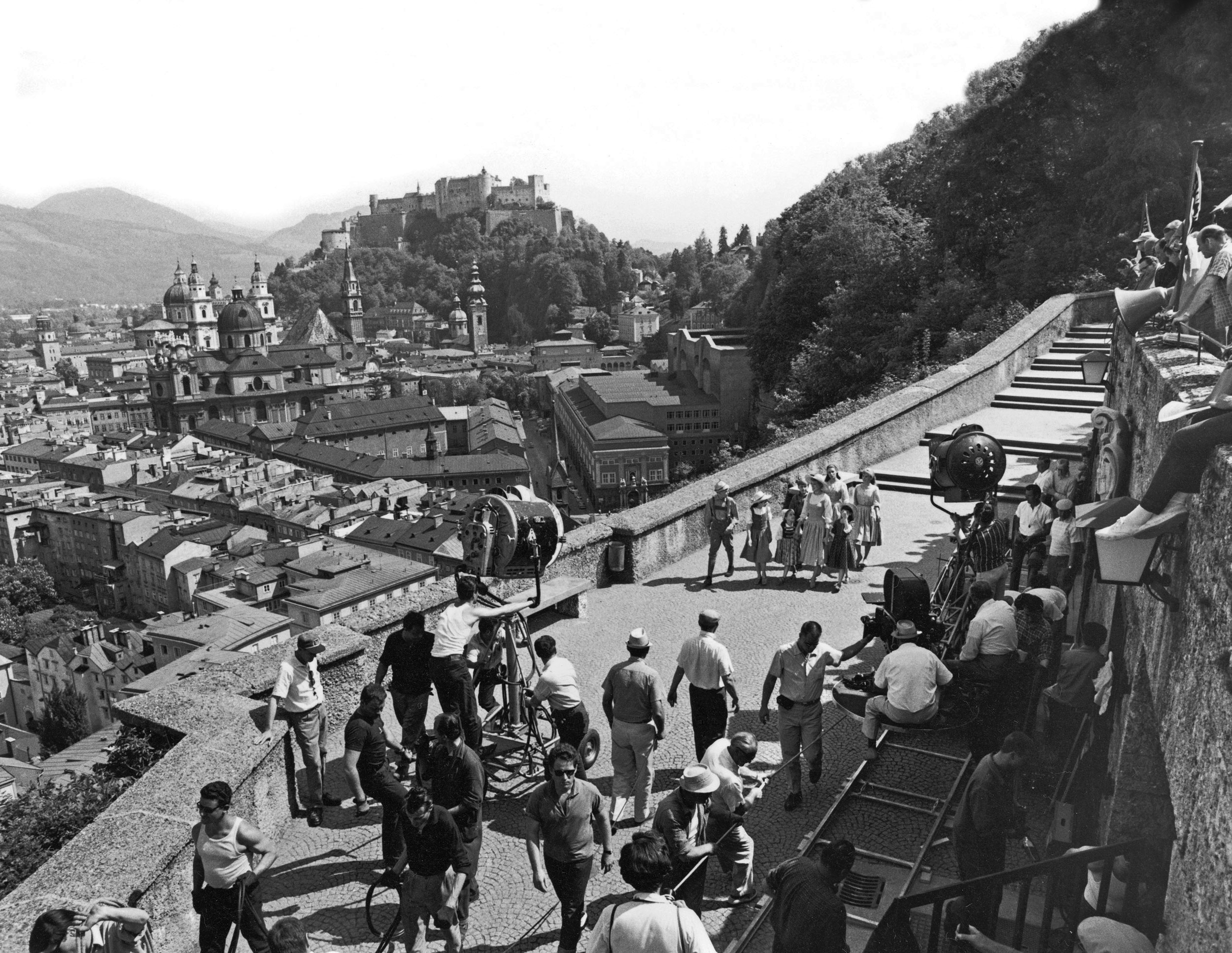 Distant view of crew filming actress Julie Andrews as Maria Von Trapp with the Von Trapp children for a scene from the motion picture <i>The Sound Of Music.</i>