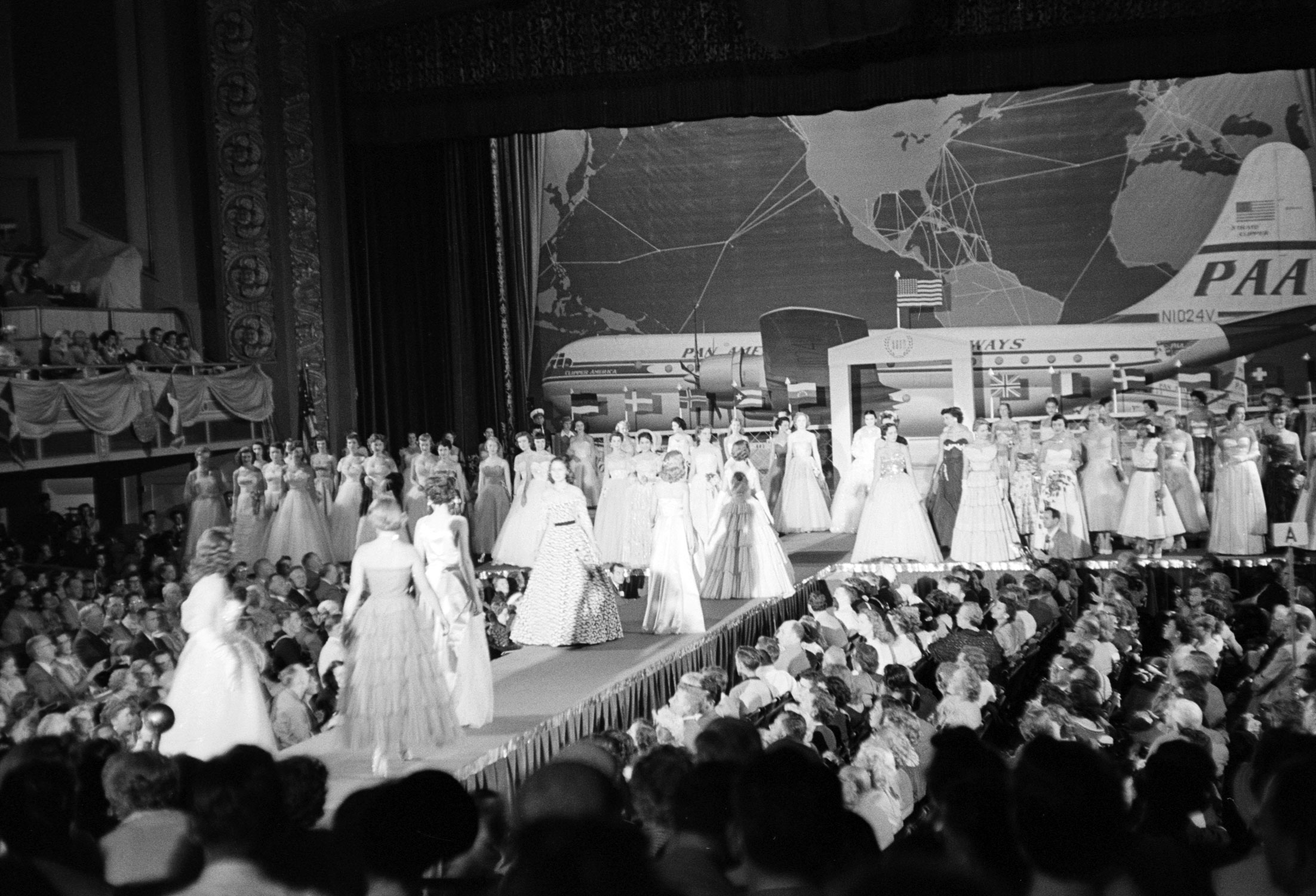 Contestants model evening gowns, 1953.