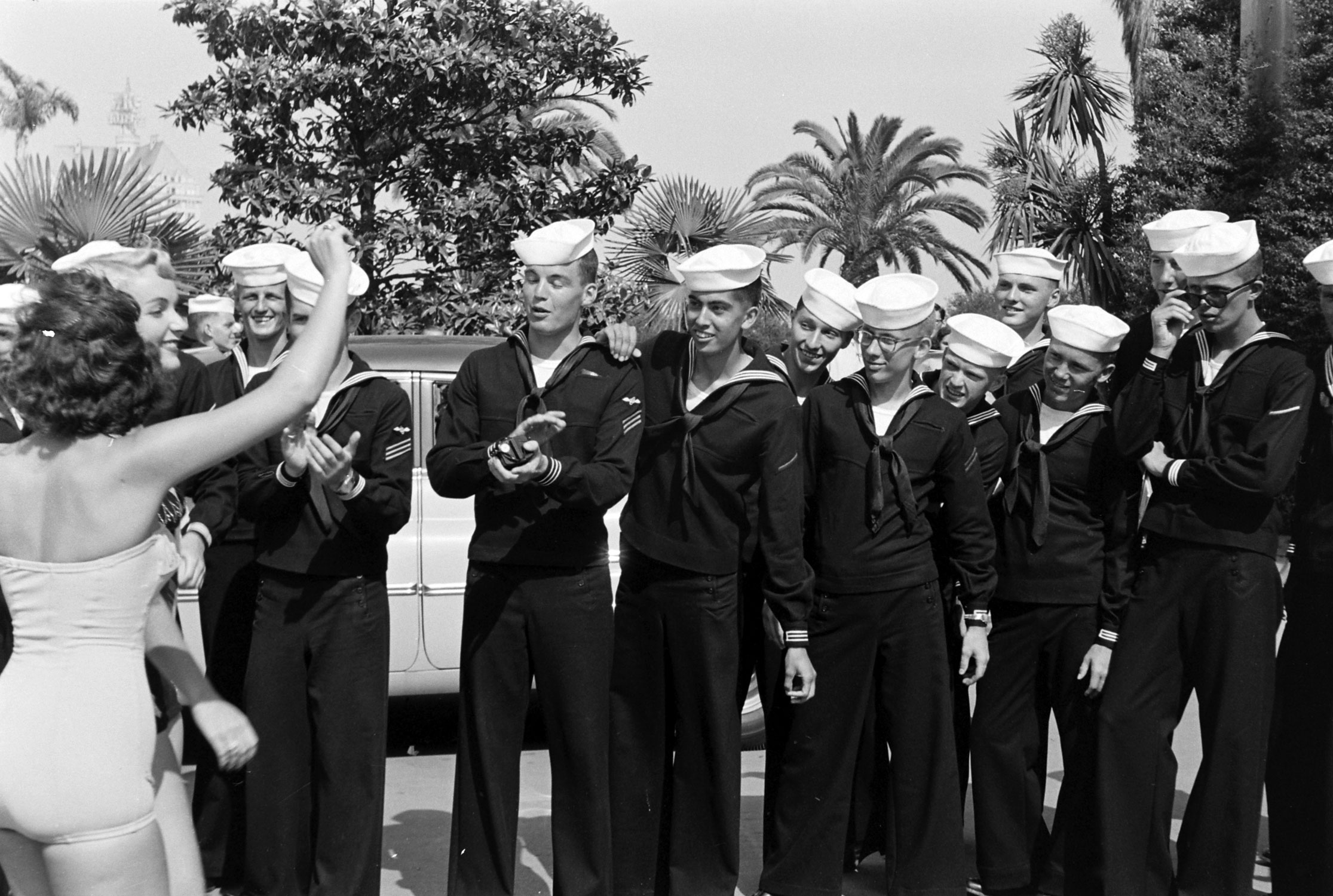Contestants are applauded by sailors, 1954.