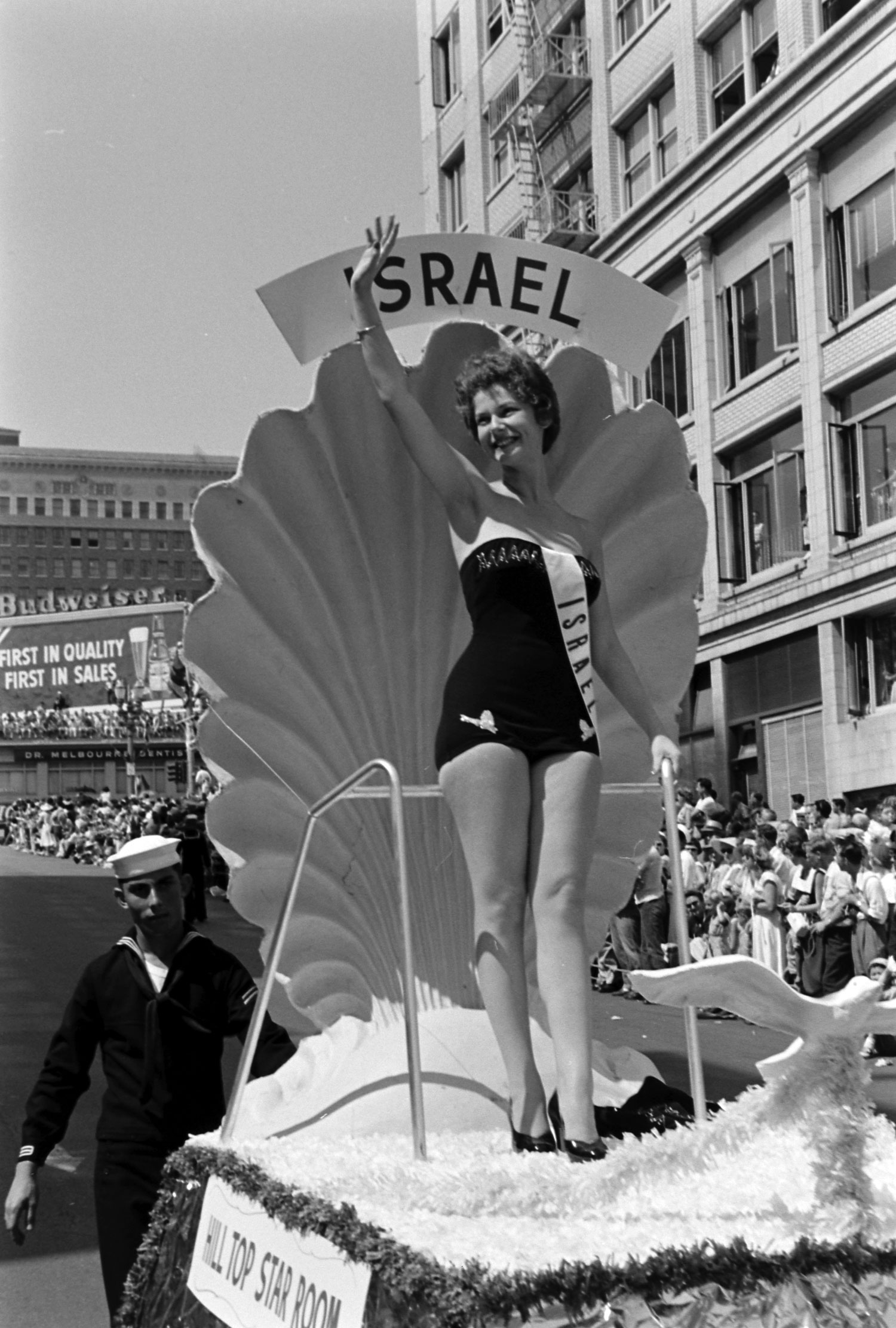 Miss Israel waves from a float, 1954.