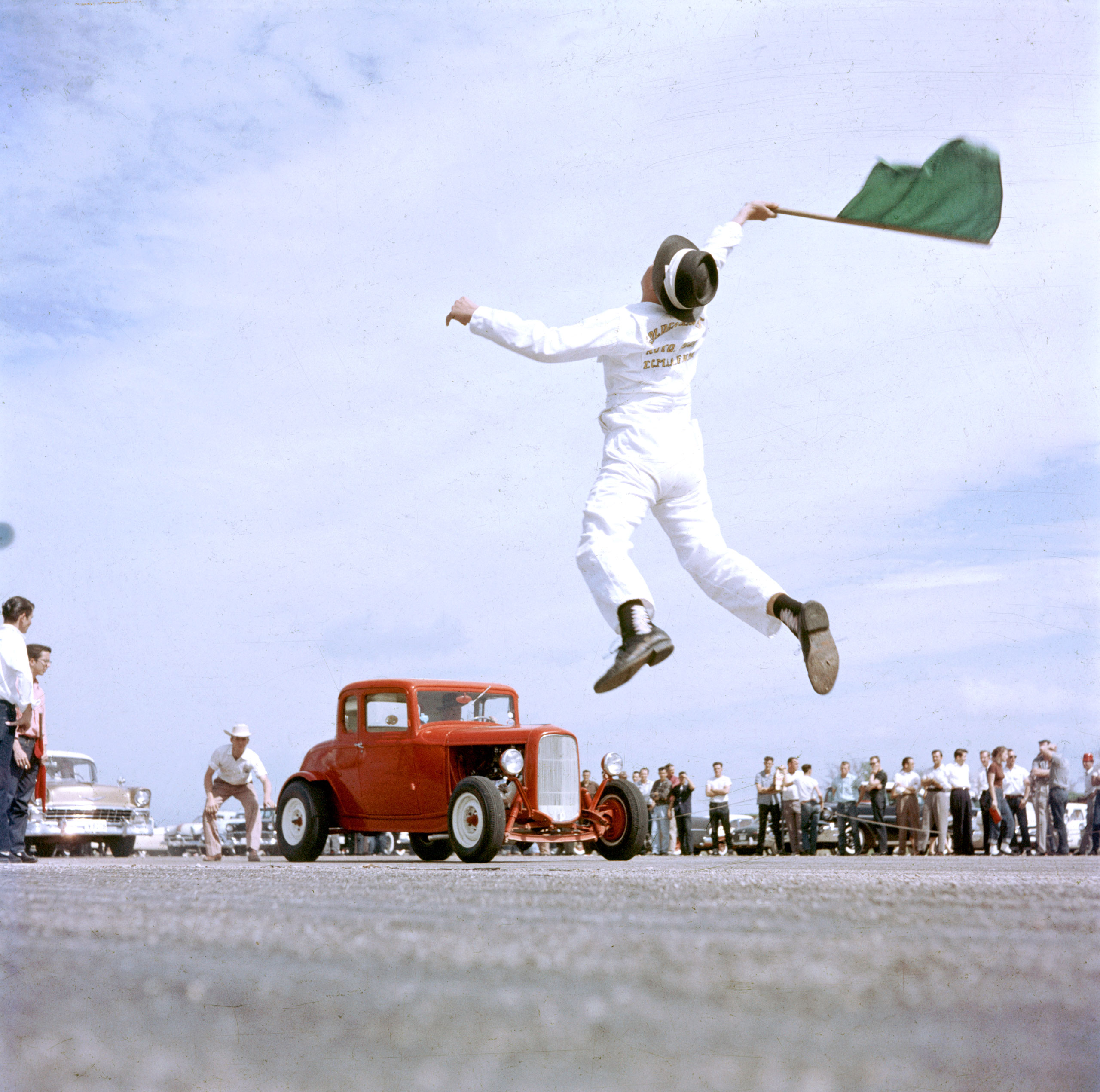 Starter flagging dragsters to start at Eagle Mt. Fort Worth, Texas 1957.