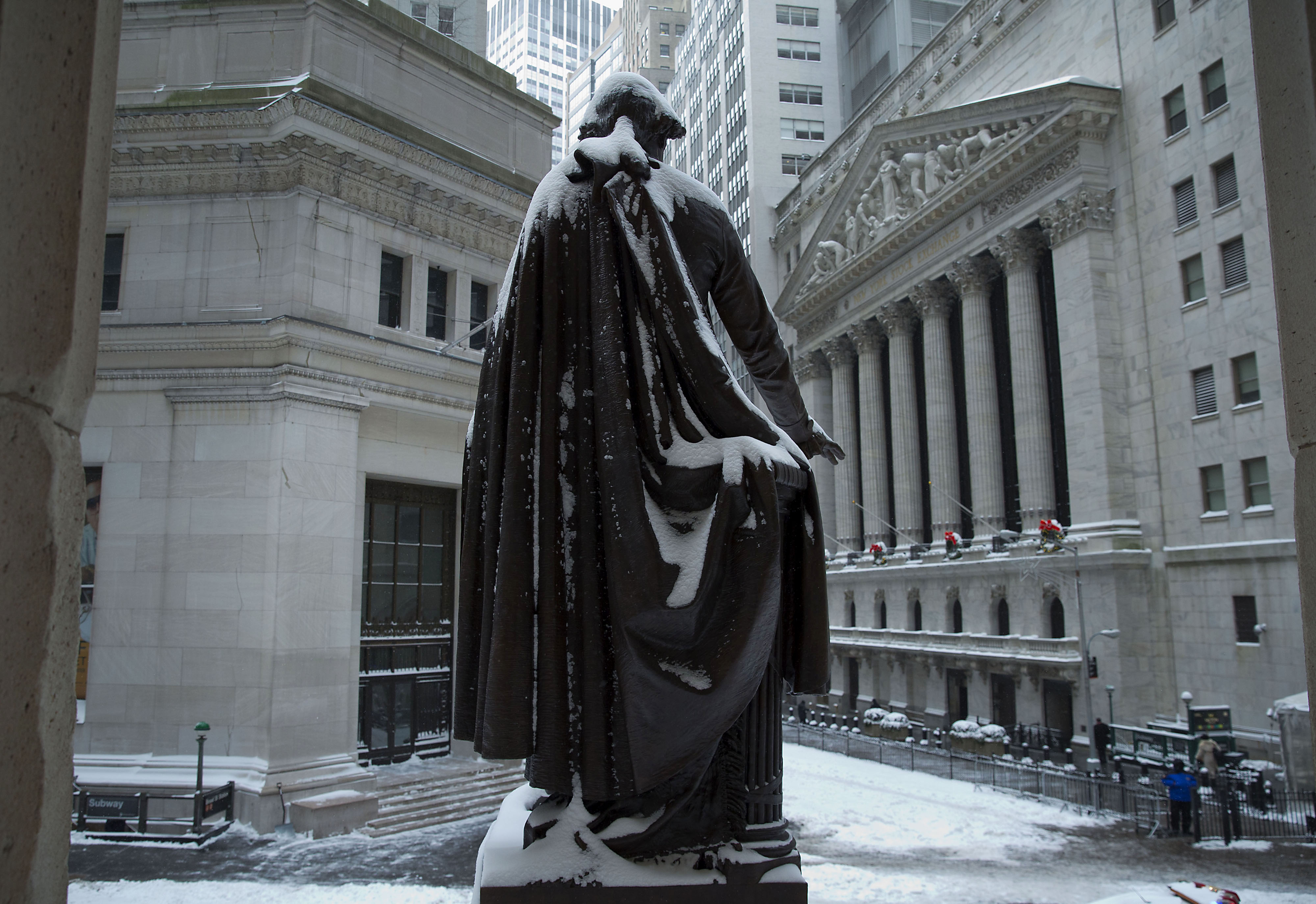 The George Washington statue stands covered in snow near the New York Stock Exchange