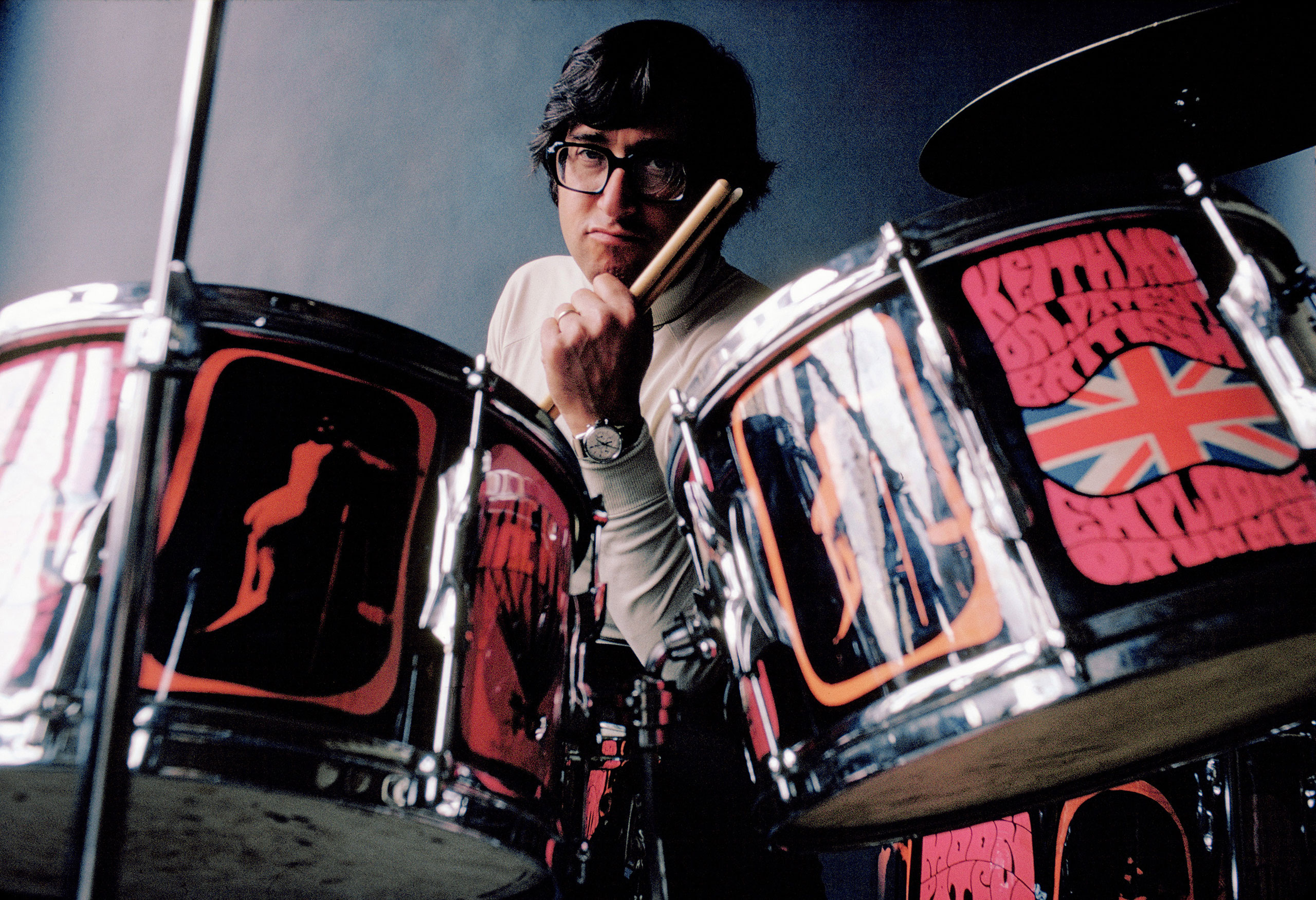 Photographer Art Kane at Keith Moon's drum set, 1968.