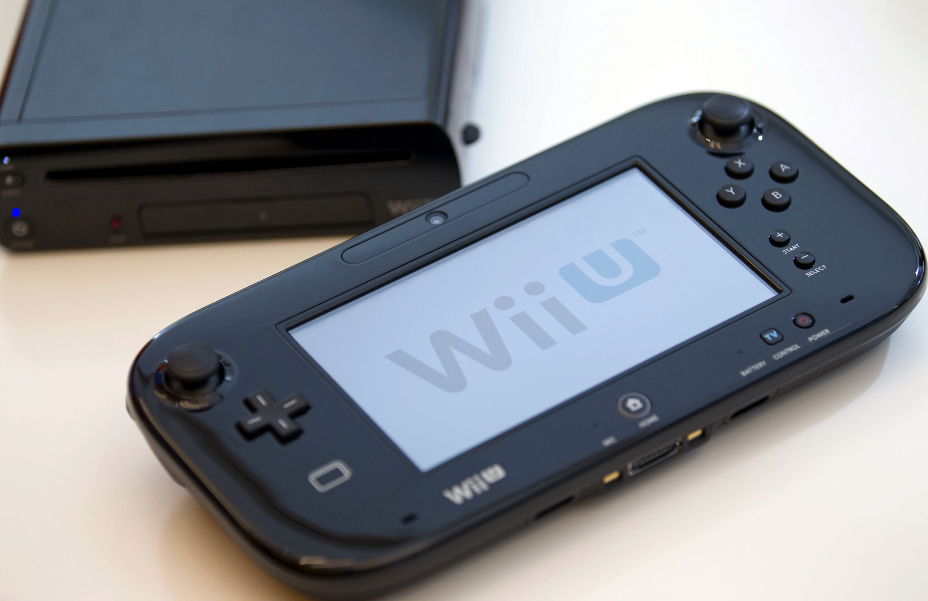 Nintendo's Wii U console, above, and touch-pad controller sit on display during an interview with Reggie Fils-Aime, president of Nintendo of America Inc., in New York, U.S., on Friday, Sept. 14, 2012.