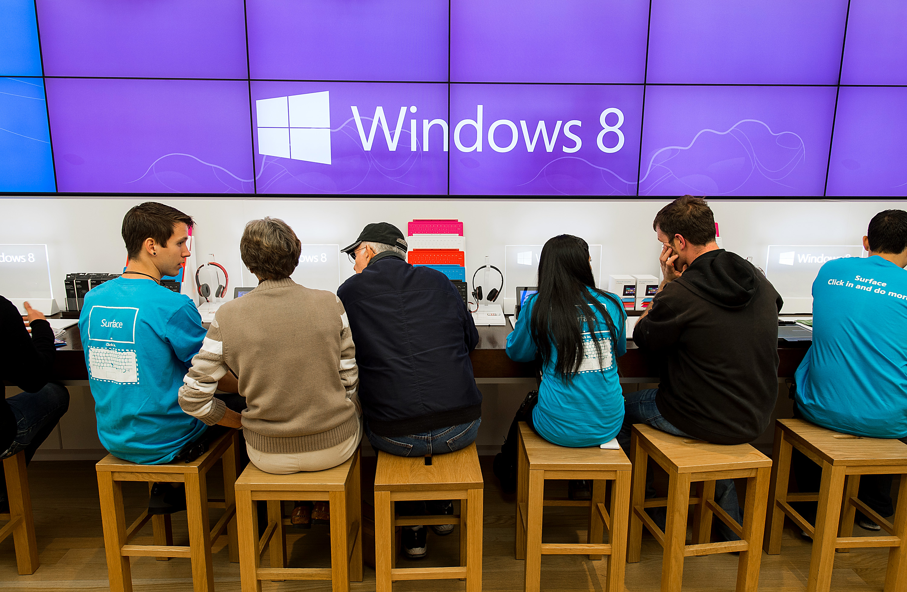 Employees assist customers at the opening of a Microsoft Corp. store in Bellevue, Washington, U.S., on Friday, Oct. 26, 2012.