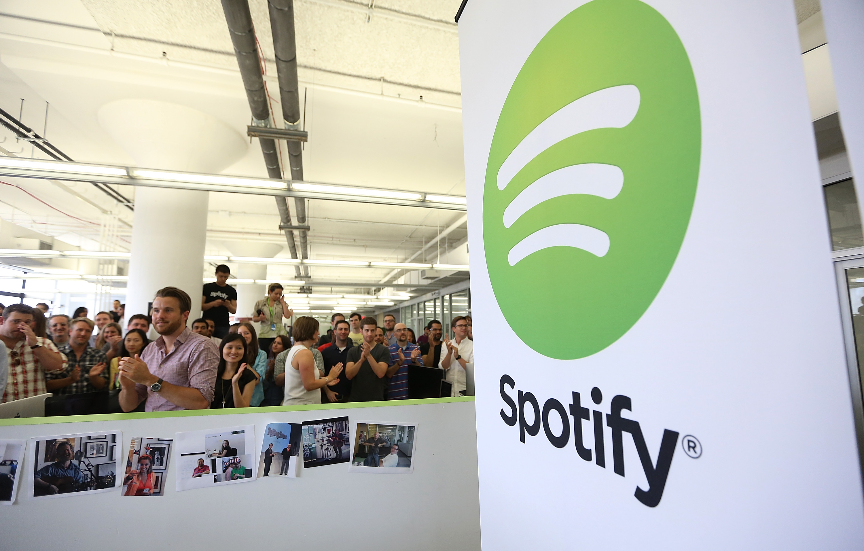 People gather in Spotify offices following a press conference on June 27, 2013 in New York City.