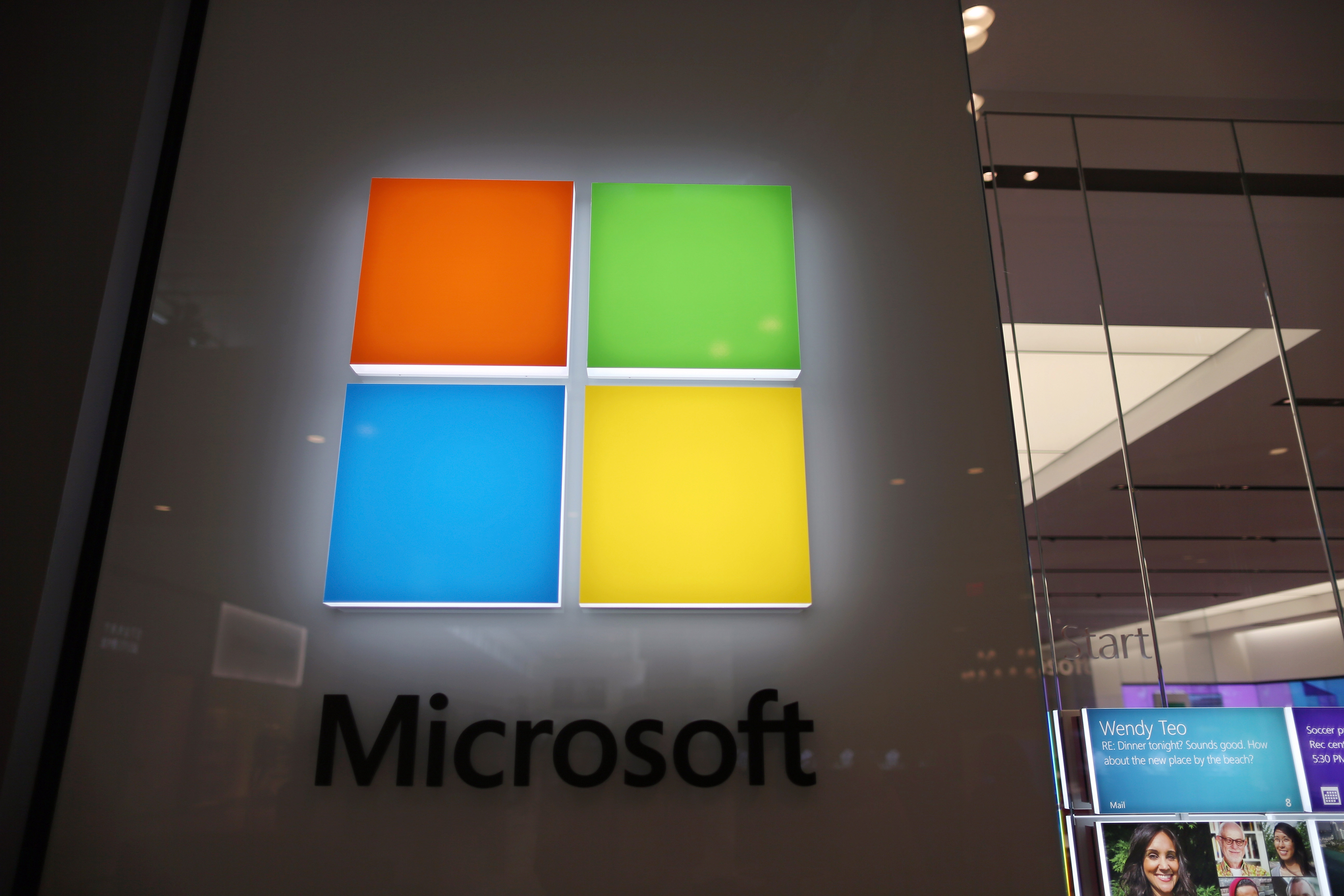 A sign is seen on the wall outside of a Microsoft store in the Dadeland Mall.