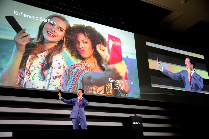 Frank Lee, Brand Marketing for LG Electronics MobileComm USA, demonstrates the enhanced selfie feature on the new LG G Flex 2 mobile phone on press day for the 2015 International Consumer Electronics Show (CES) at the Mandalay Bay Convention Center in Las Vegas on Jan. 5, 2015.