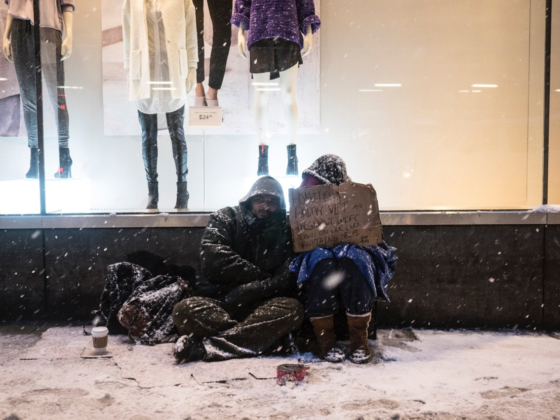 Two people huddle for warmth on the street in New York City on Jan. 26, 2015.