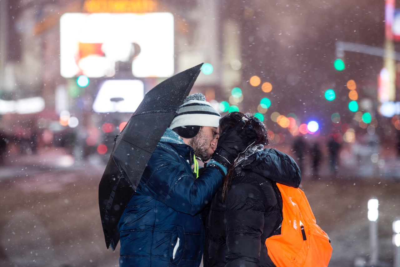 A couple kisses during a blizzard in Times Square in New York City on Jan. 26, 2015.