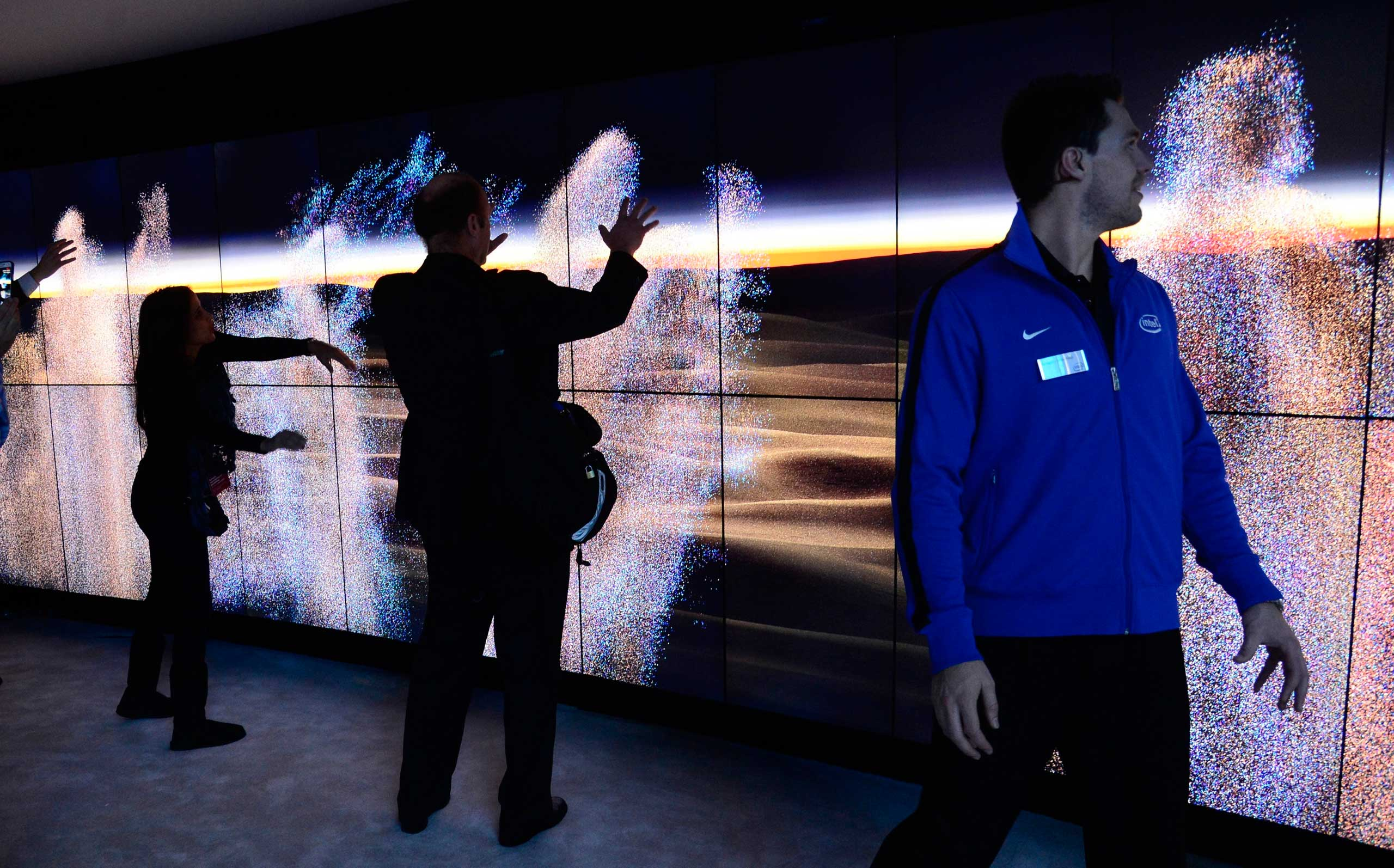 Attendees interact with wity screens that run on Intel's Realsense technology on Jan. 6, 2015.