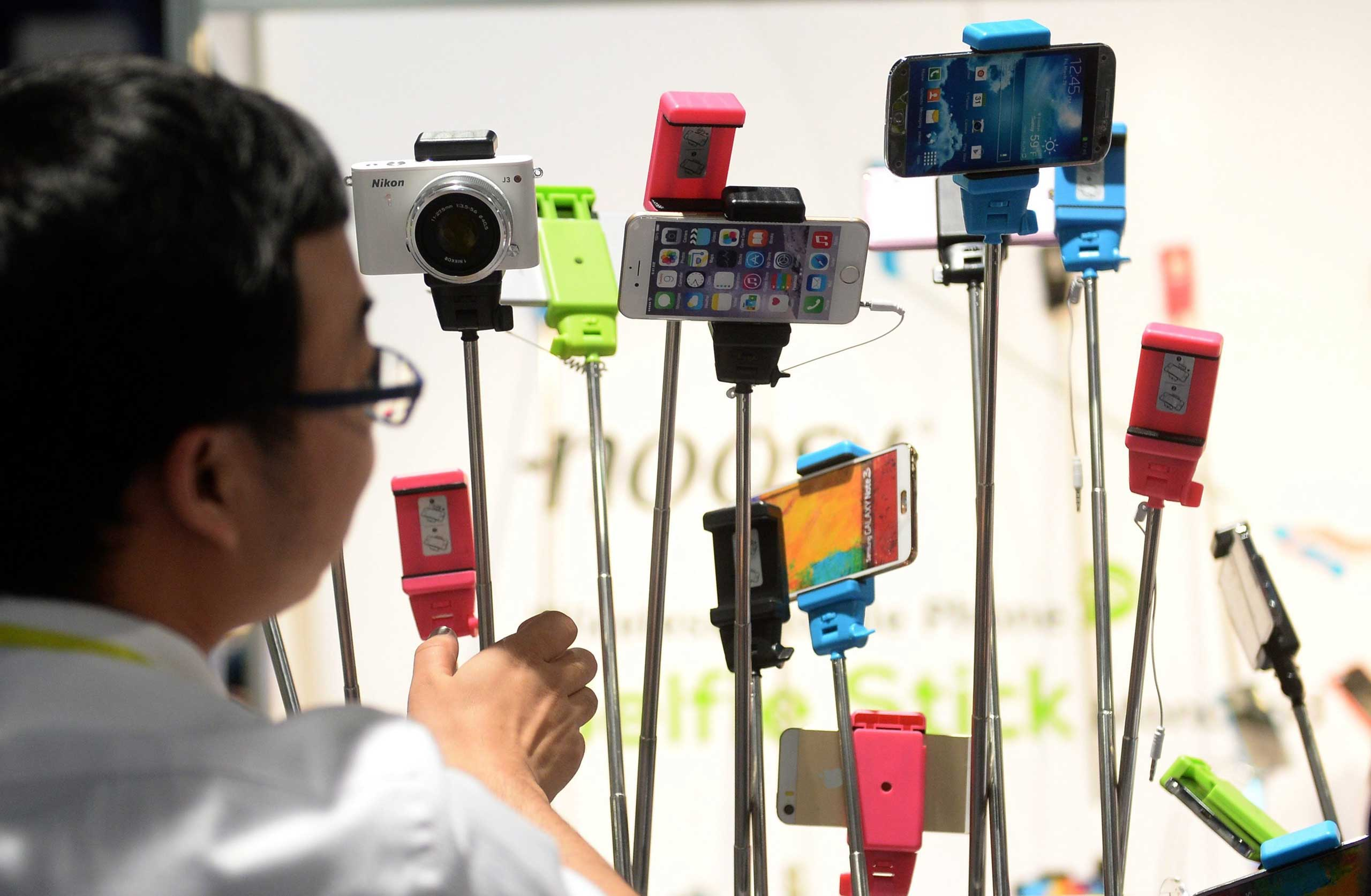 Selfie sticks of the company 'Noosy' displayed on Jan. 8, 2015.