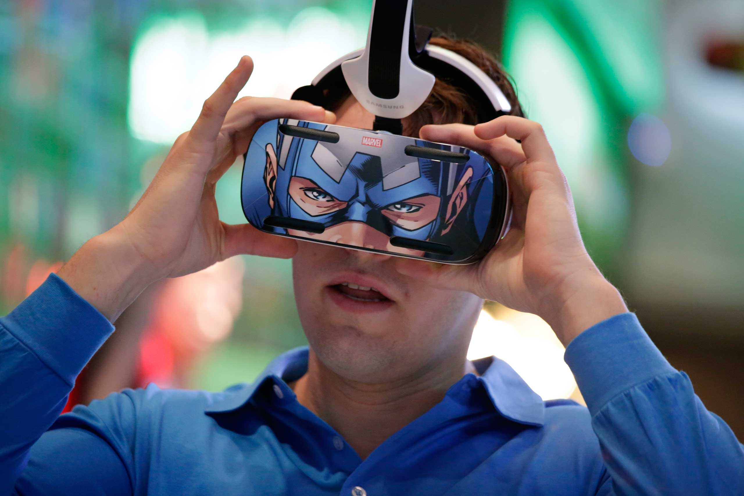 A brand ambassador tests Samsung's Gear VR headset at the Samsung Galaxy booth on Jan. 6, 2015.