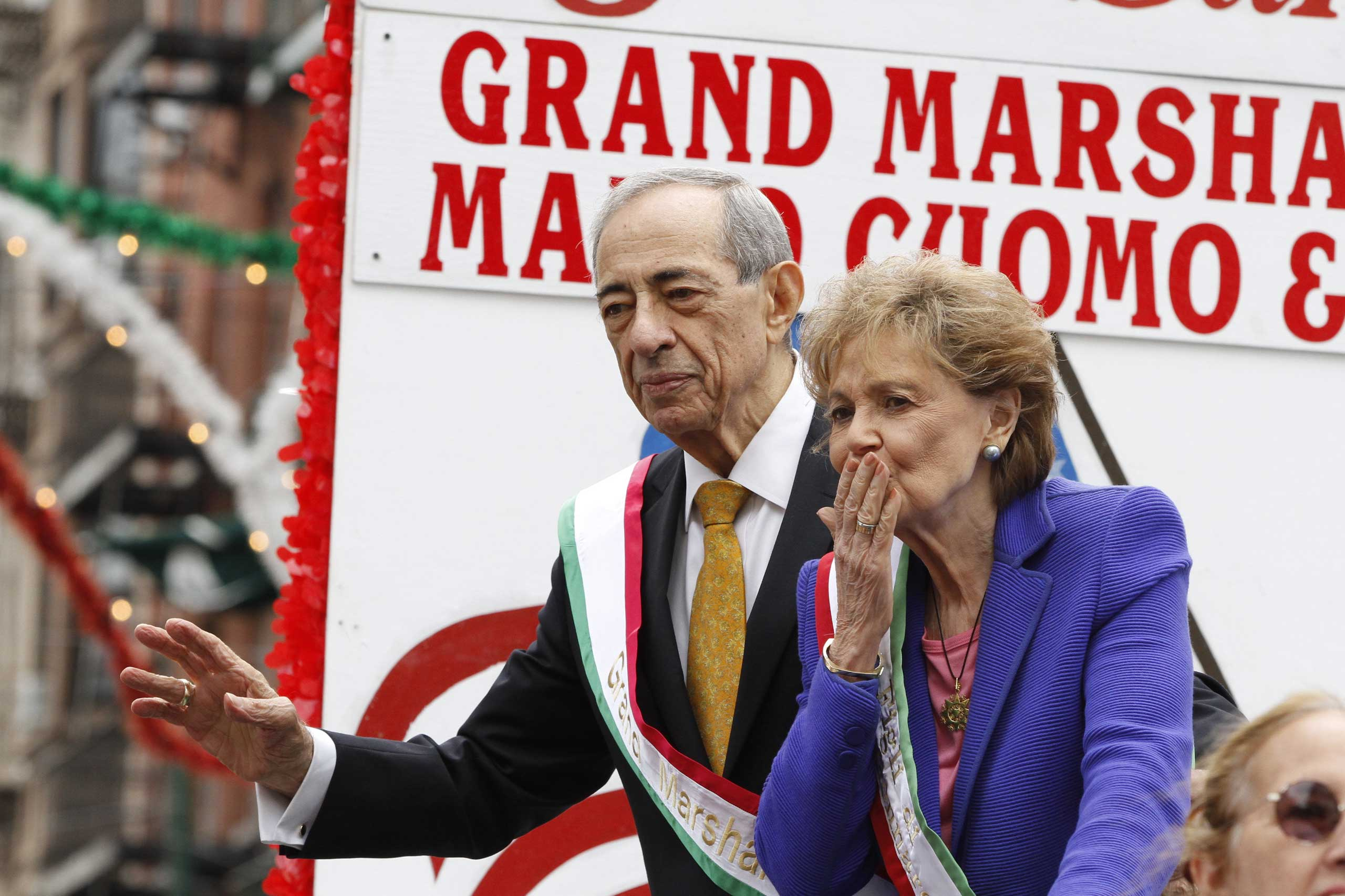Former New York Governor Mario Cuomo, accompanied by his wife Matilda Cuomo, serves as the Grand Marshal of the San Gennaro Grand Procession, kicking off the 87th annual San Gennaro Festival in the Little Italy section of New York City on Sept. 14, 2013.