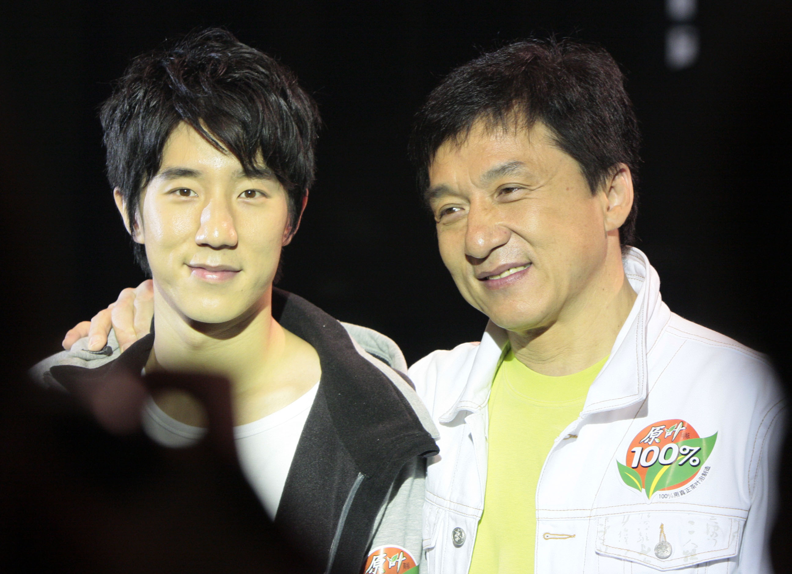 Jackie Chan and his son Jaycee Chan attends a commercial event on April 5, 2008, in Shanghai