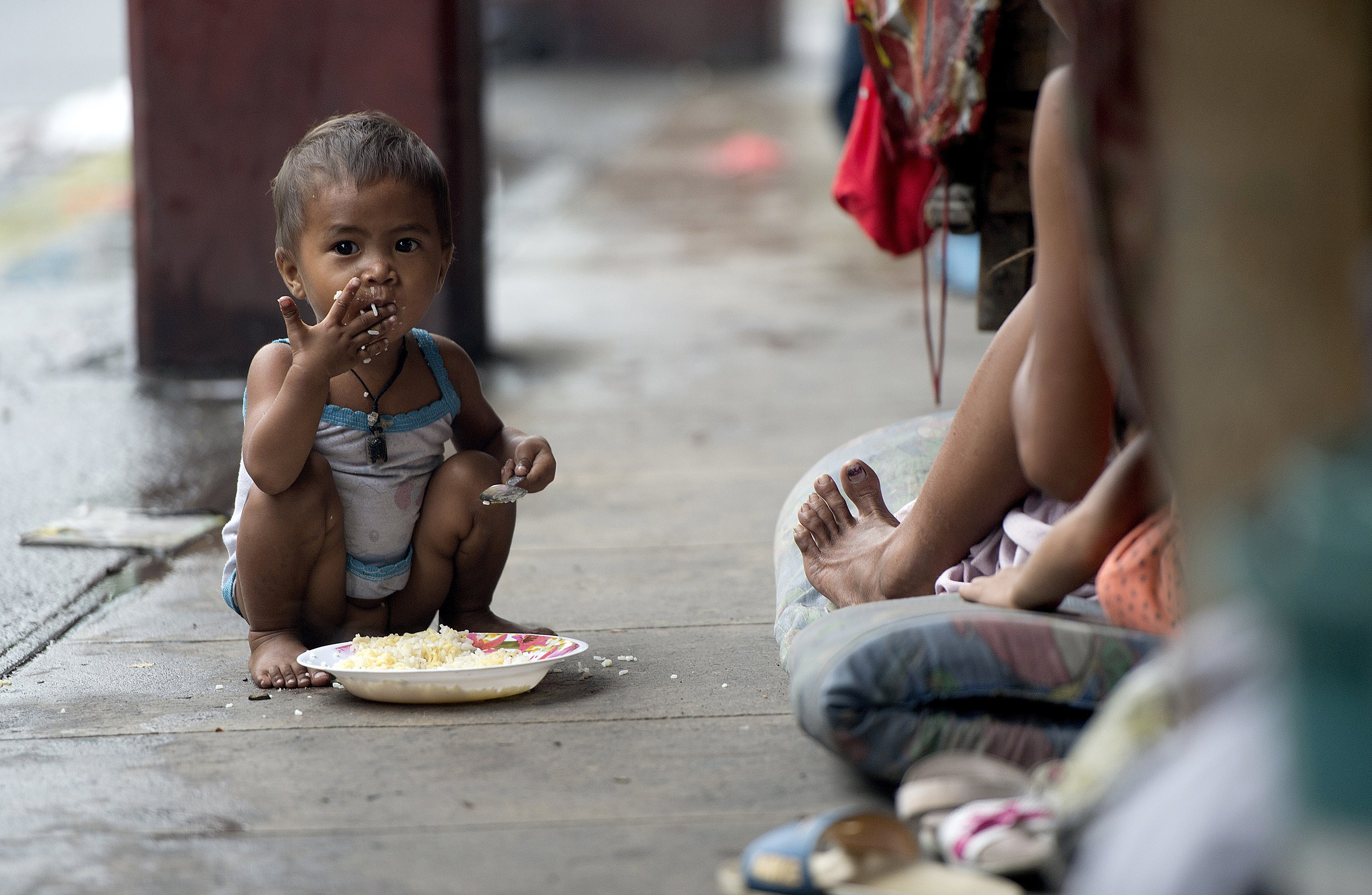 A homeless child in the streets of Manila in 2014.