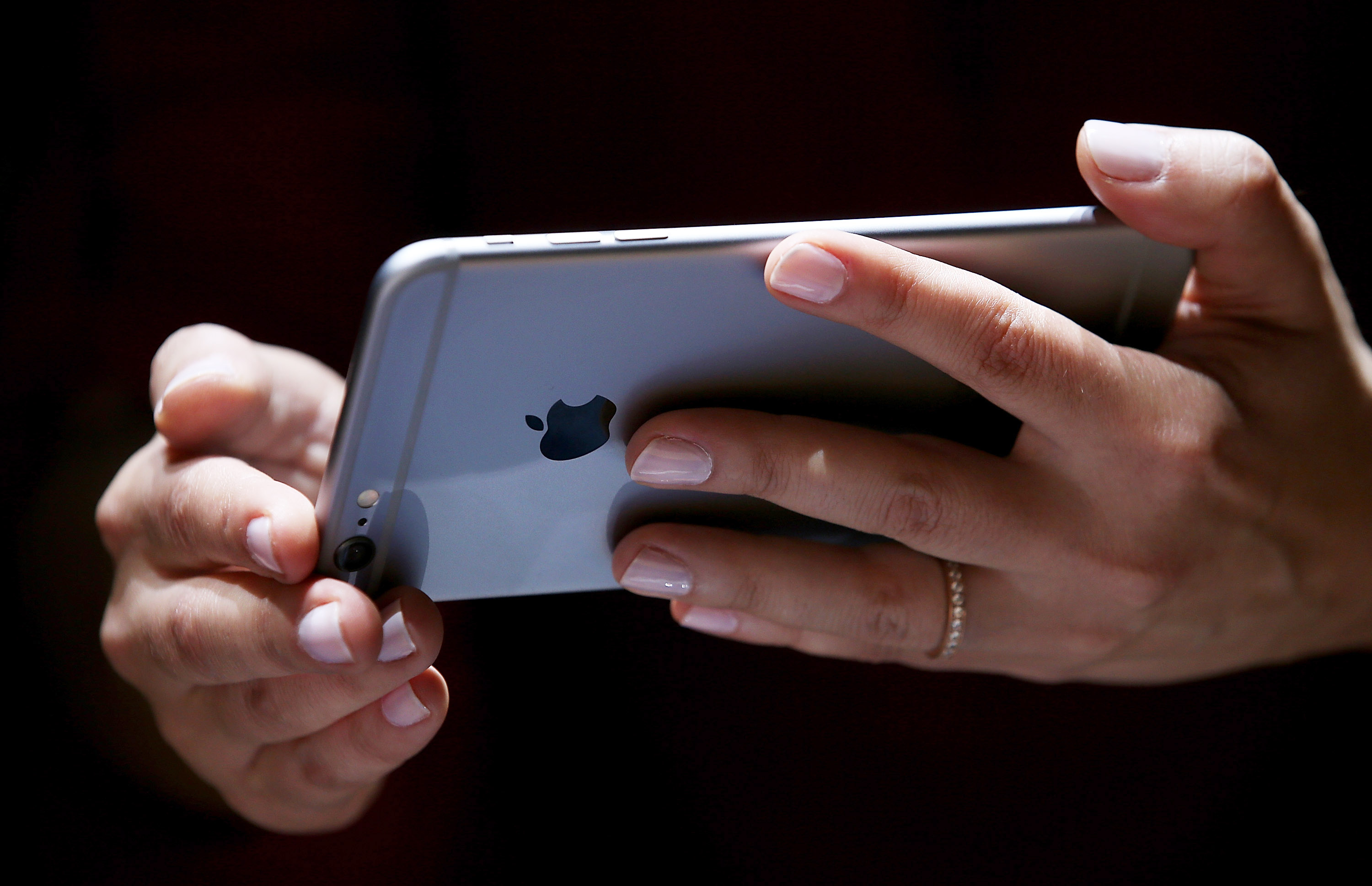 A member of the media inspects the new iPhone 6 during an Apple special event at the Flint Center for the Performing Arts on September 9, 2014 in Cupertino, California.