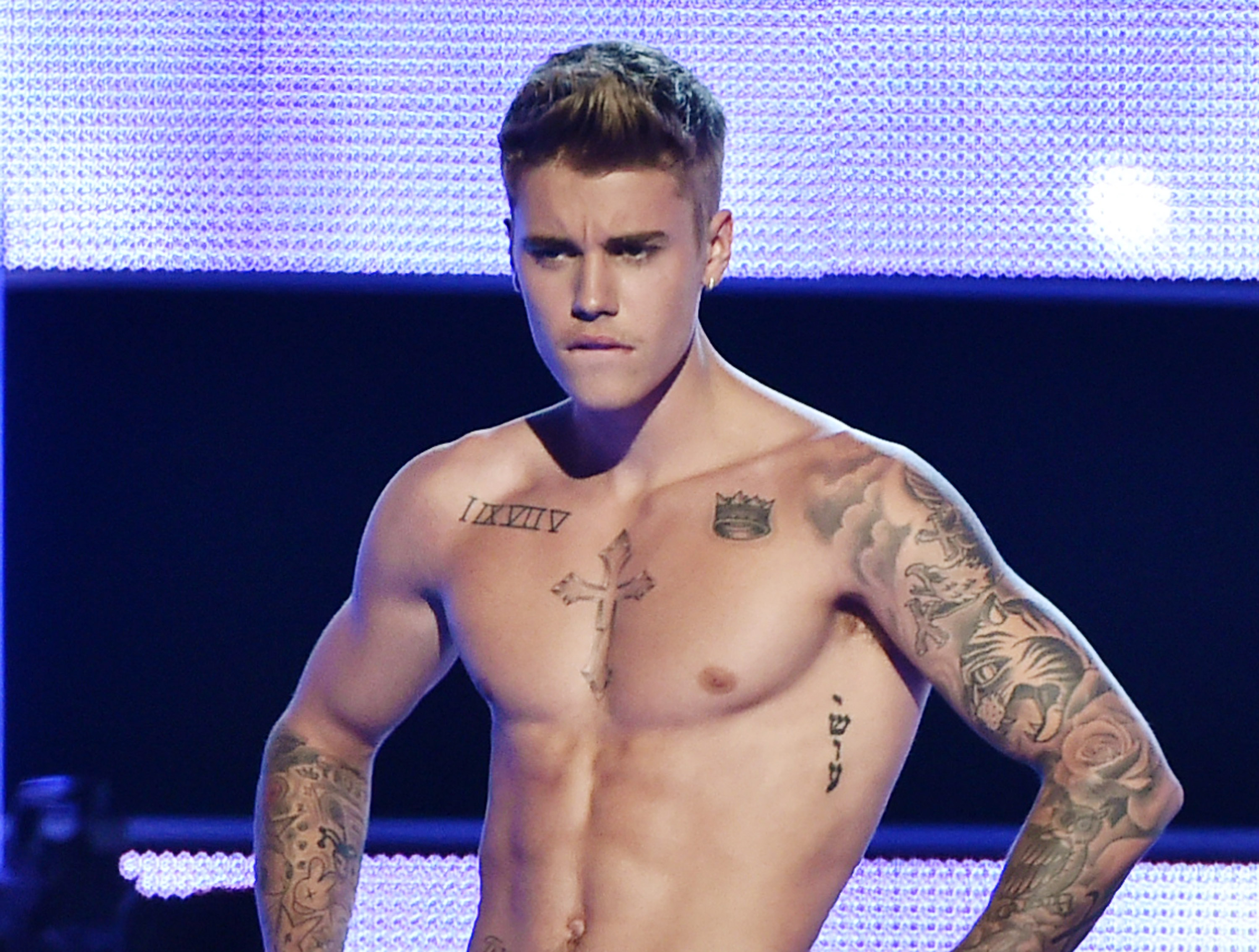 Singer-songwriter Justin Bieber presents onstage at Fashion Rocks 2014