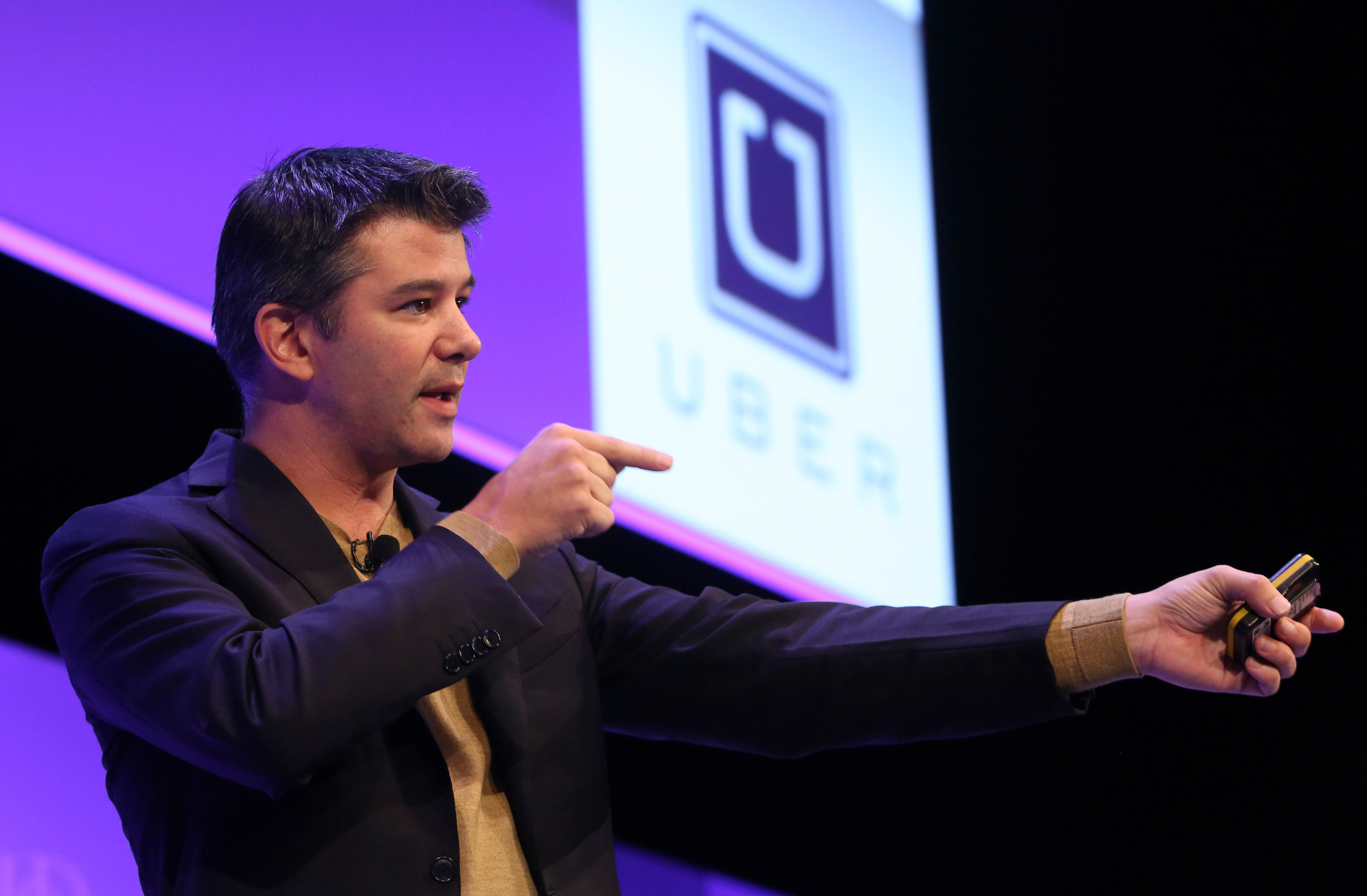 Travis Kalanick, chief executive officer of Uber Technologies Inc., gestures as he speaks during the Institute of Directors (IOD) annual convention at the Royal Albert Hall in London, U.K., on Oct. 3, 2014.