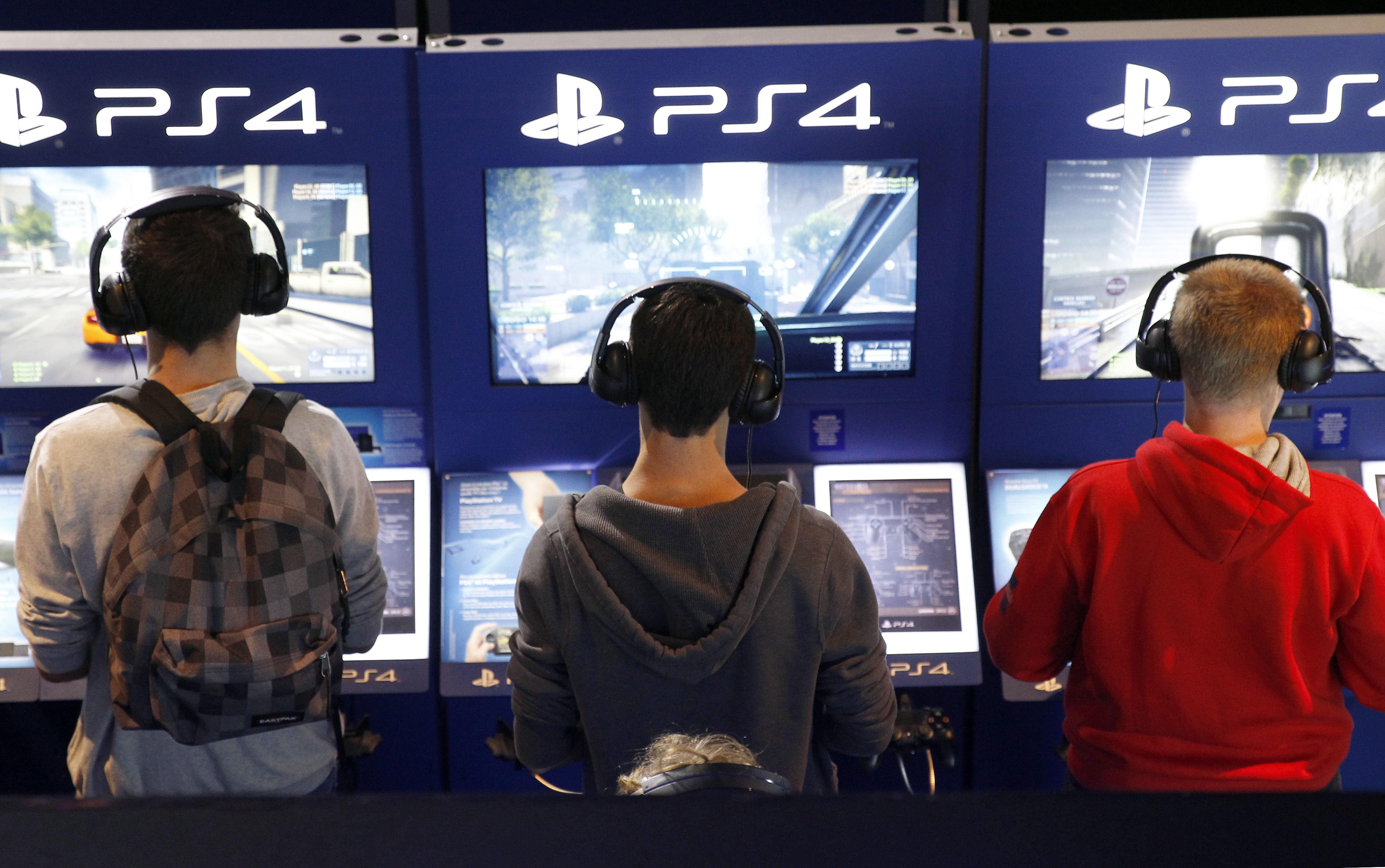 Gamers play video games with the PS4 consoles of Playstation during the International Games Week on October 29, 2014 in Paris, France.